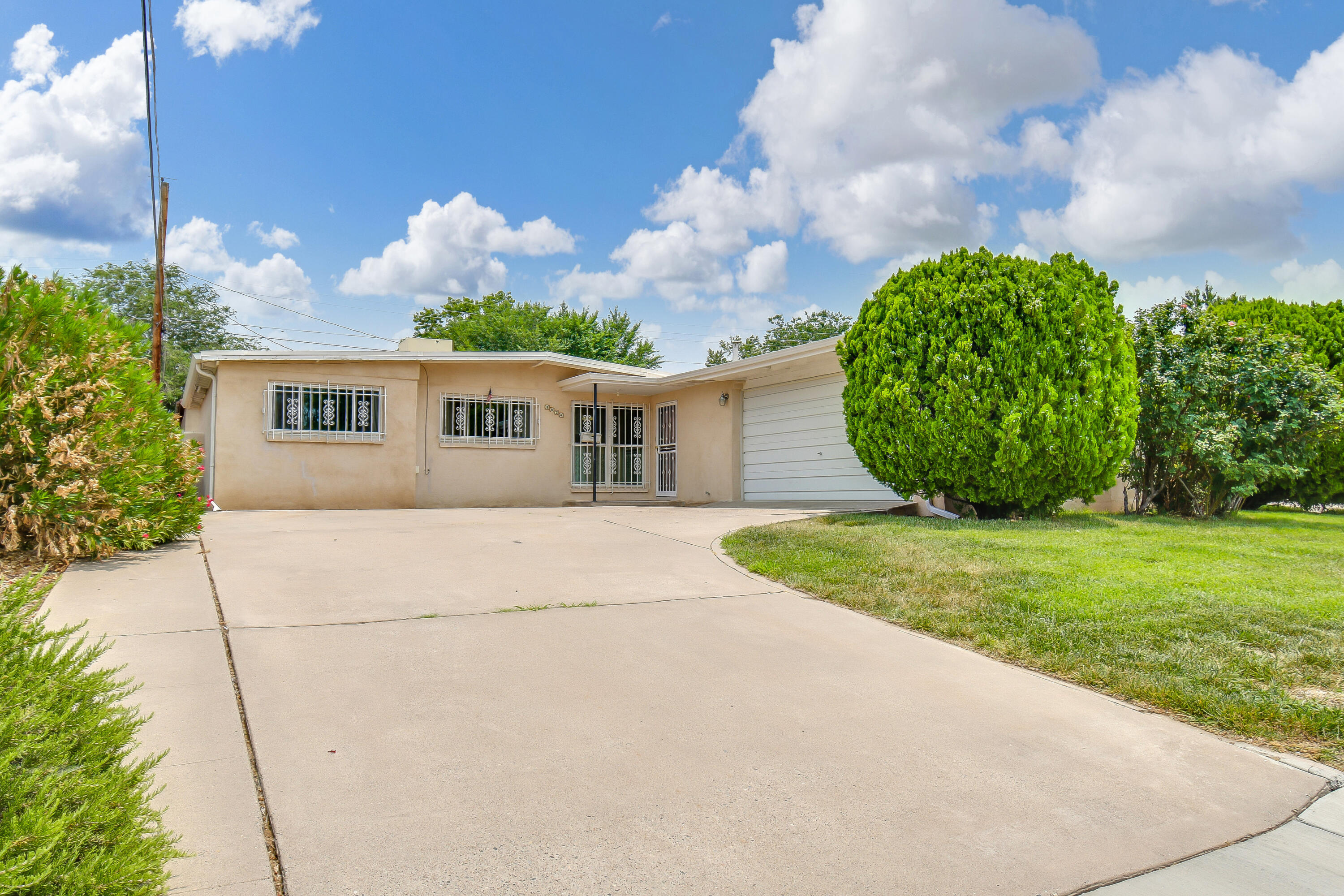 Great Northeast Heights location with Charming Curb appeal!! Open Kitchen, Dining, and Living area make a great place to entertain family and friends! The updated kitchen boasts granite countertops, hickory cabinets, updated light fixtures, and tile flooring. Beautiful newer laminate floors throughout the main living area and bedrooms! There is a flex space off the Dining room and Owners suite that can be used as a second living or dining area, game room, or craft room! Relax after a long day out on the large covered patio. Transferable roof warranty good until 2027 upon transfer! There is a 9x10 Tuff Shed in the back to store all your yard tools. Take a virtual walkthrough tour or schedule a private showing!