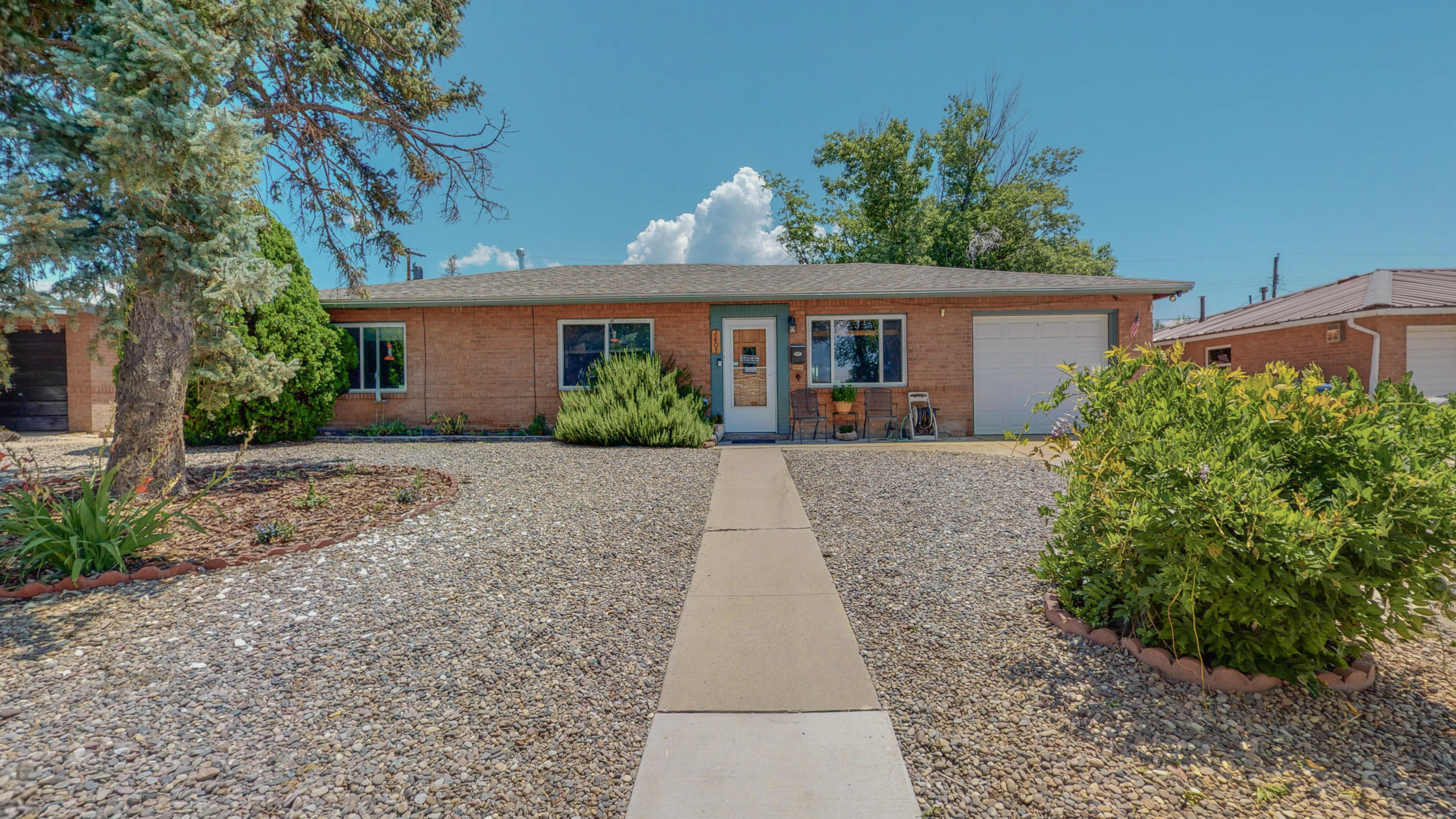 Don't miss this charming home in the heart of Albuquerque.  Three good size bedrooms, 1 3/4 baths.  New roof in 2017 and all new windows installed in 2020. Fresh paint.  Carpet in bedrooms, laminate floors and ceramic tile throughout the rest of the home. Totally landscaped front and backyards.  Amazing backyard with beautiful full garden!  Newly built shed with custom made work bench on the back exterior. Close to schools for all ages, shopping and restaurants. Parks in the area.  Move in ready! Don't miss this one!