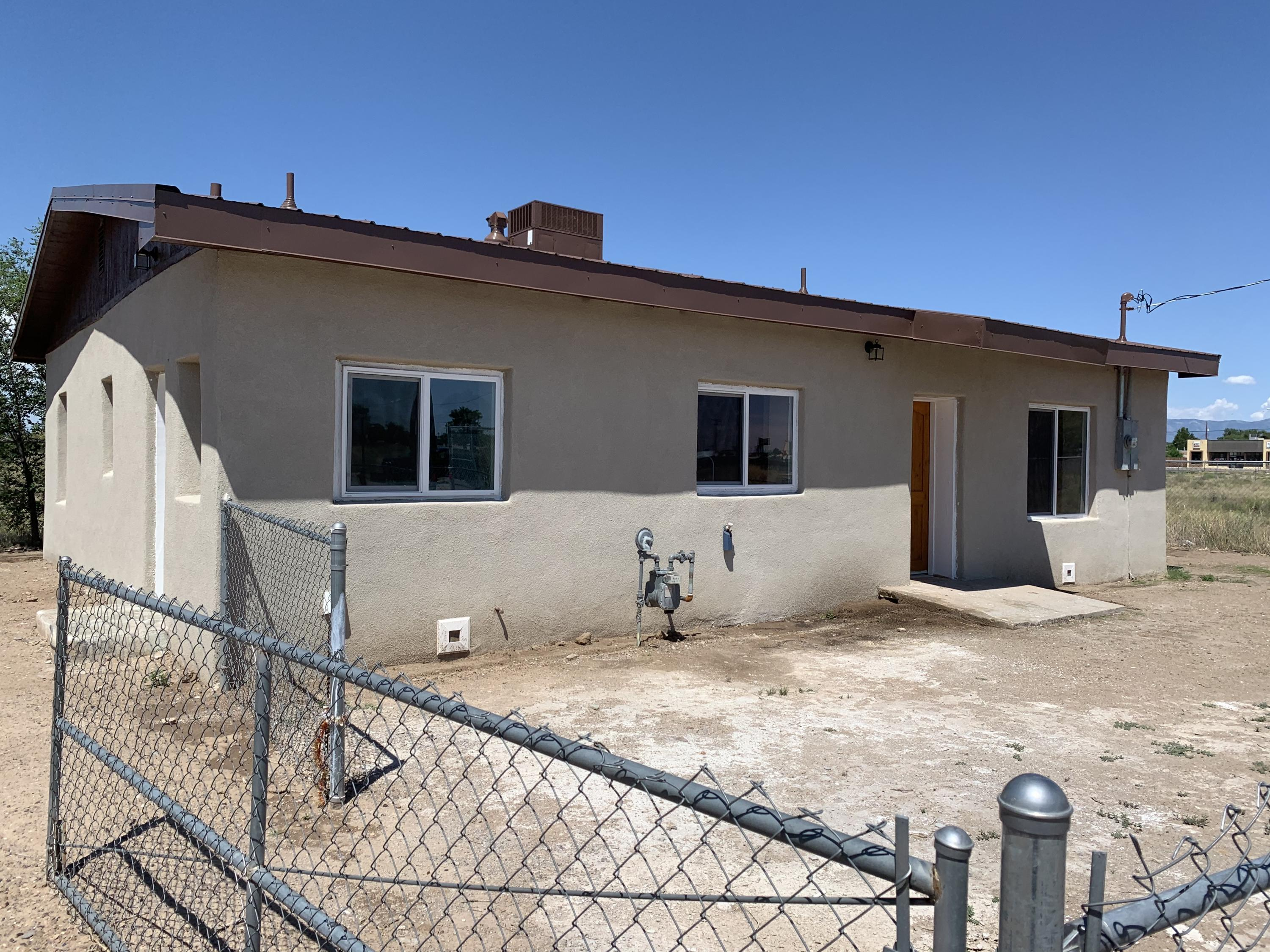 Quaint remodeled adobe home in the heart of Belen.  Easy access everywhere, fully fenced yard.  This home is ready to move in.  It has great natural lighting and an open floor plan.  Come see this home today
