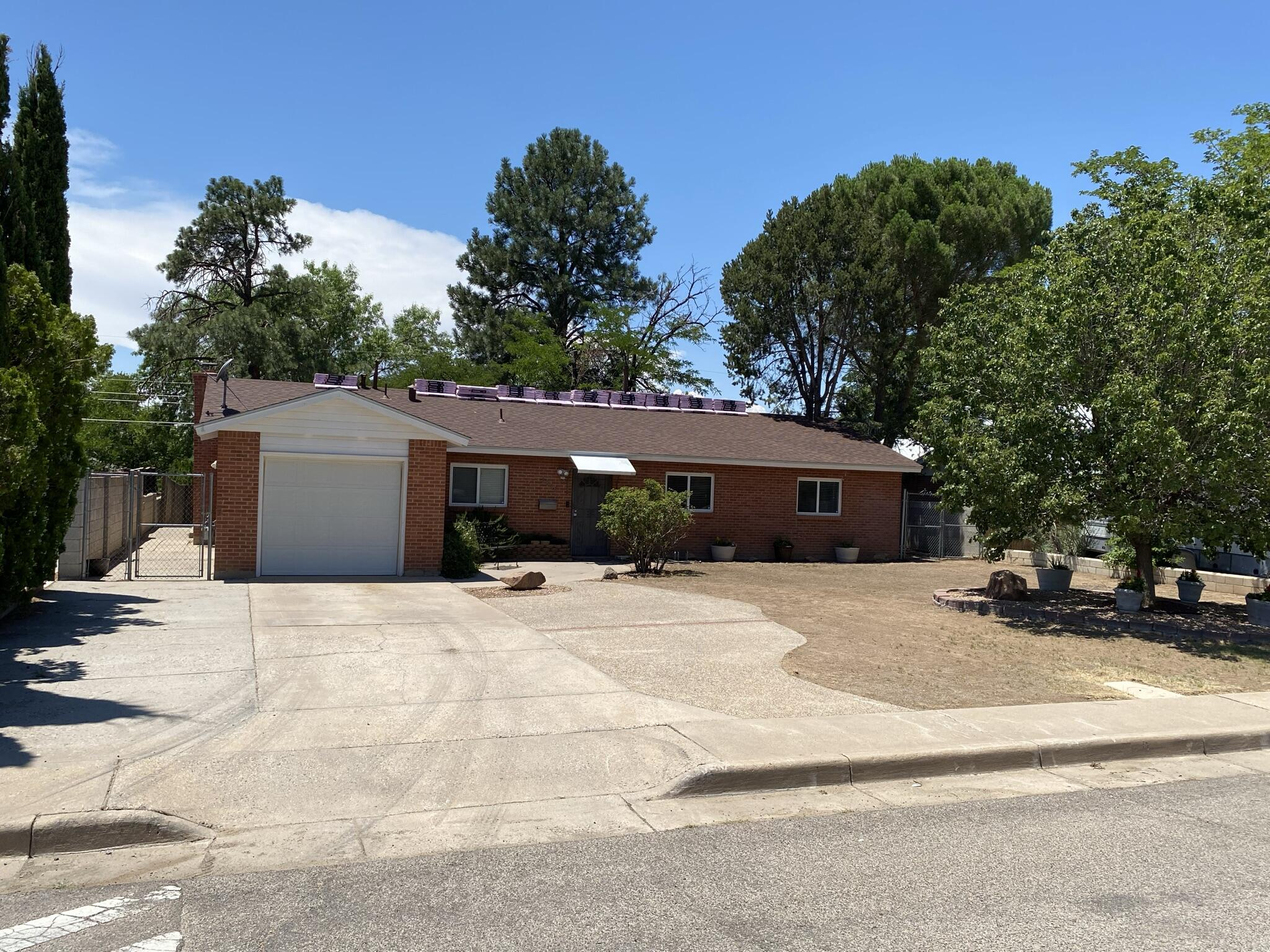 Updated and upgraded home in the Sandia High school district. This home just had the roof replaced 7.10.21. The electric drop and box has been upgraded in April 2021. The hot water heater is from 2015. The home has newer flooring through out home with upgraded tile wet areas and shower surrounds. The home has a master cool unit as well as a ac unit in the extension. This beautiful home has a stone fireplace in the living room with a pellet stove in the extension. All appliances and window coverings convey.