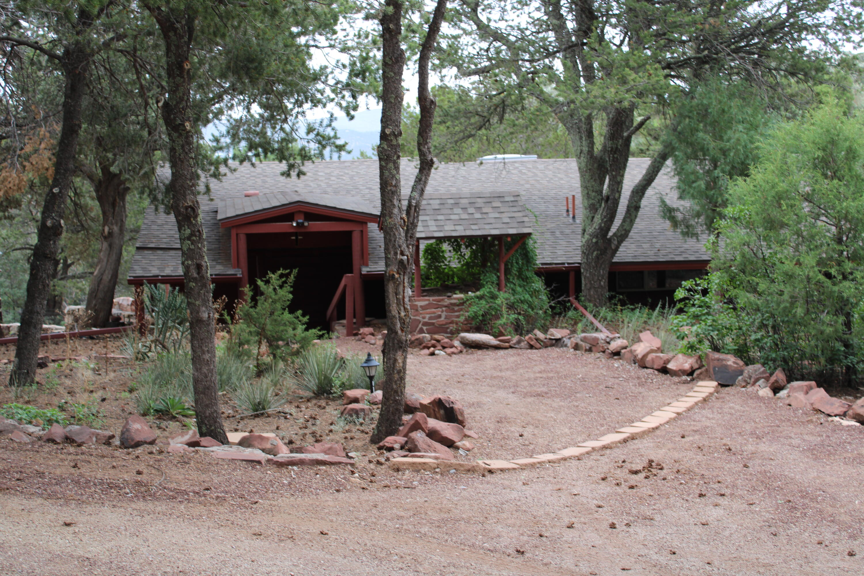 One of the few remaining estates in the East Mountains.  Two cabins on 10 lush acres adjoining the National Forest.  Original cabin built in 1936 (1609 sq ft) 3 bedrooms, 1.5 baths, 2 car detached garage.  Guest houswe is 884 sq ft, 2 bedrooms, 1 full bath, kitchen and service room.  Currently rented for $900.00 a month.  Both homes have stone fireplaces, hardwood flooring with old world charm.  Fabulous views from remaining acreage.