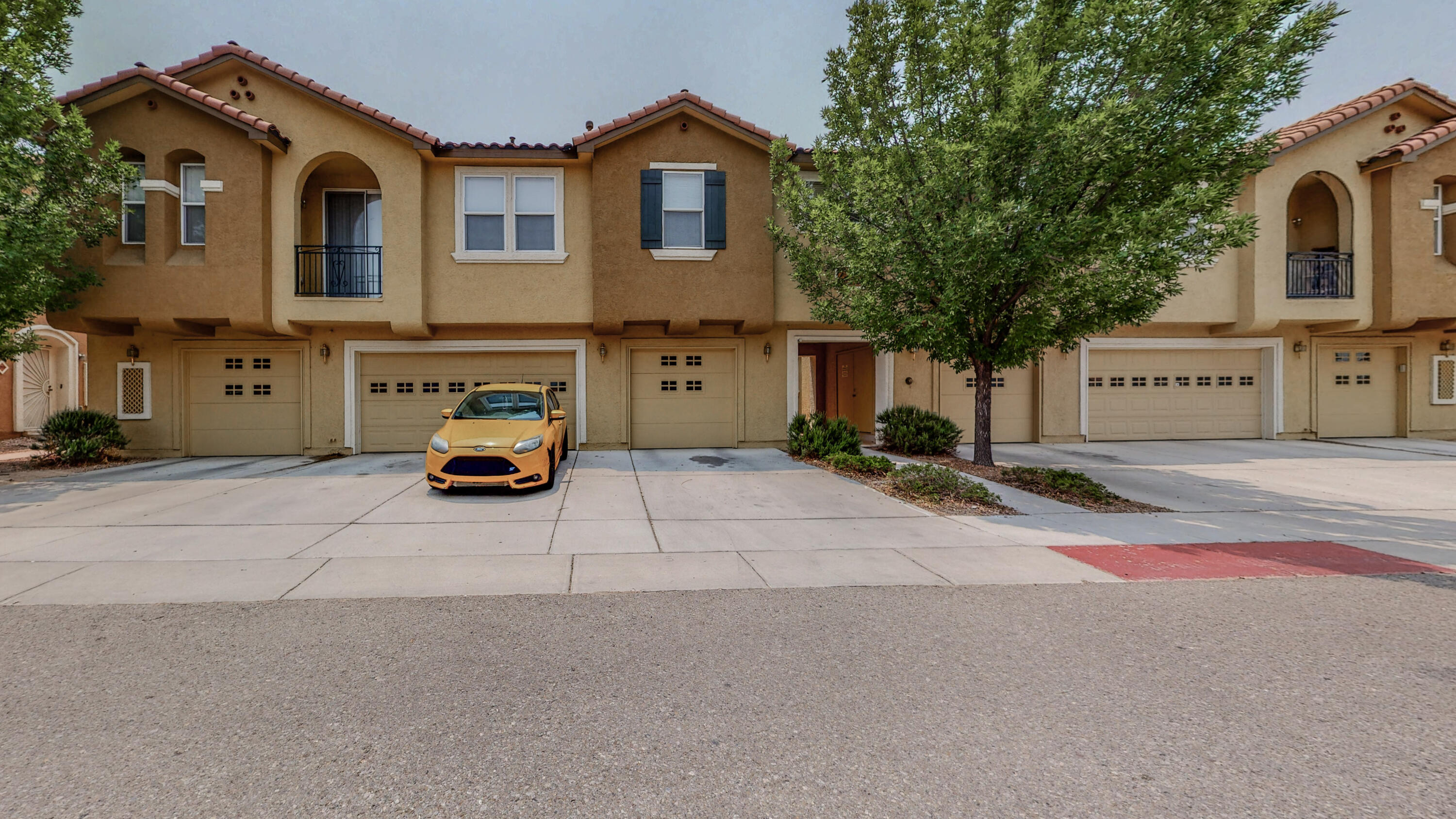 Welcome Home!  Highly sought after condo complex, The Villas, conveniently located very close proximity to I-25, UNM, CNM and much more!  Home features updated vinyl plank flooring, granite counters in kitchen, 1 car garage, and good sized private backyard!  HOA includes front gate, exterior of residence, pool, and water!  Come see today!