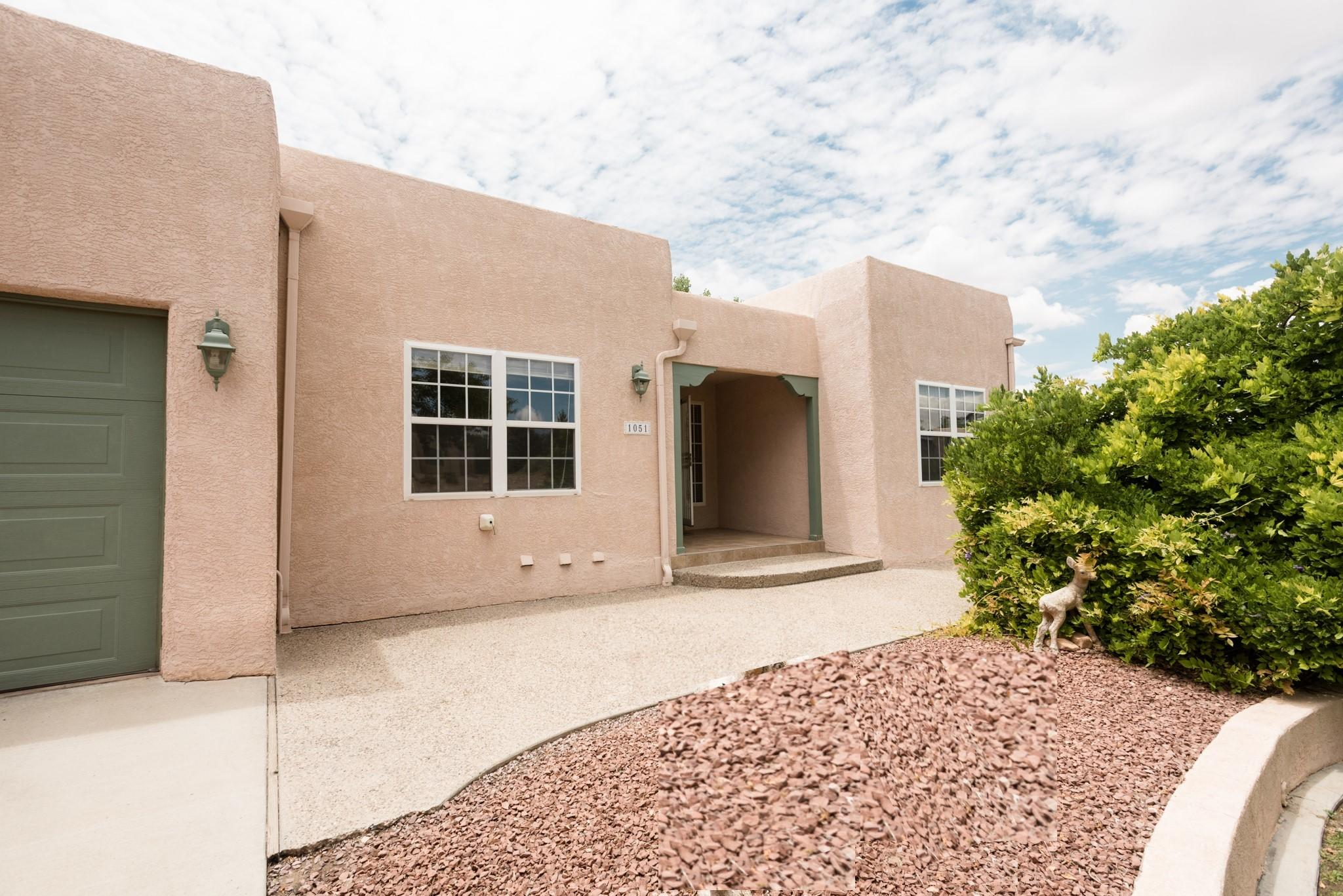 Beautiful custom built home located on a fully landscaped parcel with views of the Los Lunas Hill. Enjoy the sunsets from your covered back porches. Bring your RV, your trailers, and all your recreational vehicles this home has space. Three car garage with storage on main level and two car extended lower garage has large workshop not to mentioned the covered carport. The large open kitchen has an island and peninsula, lots of room to cook and bake all your culinary masterpieces. Home features a large laundry room with ample storage, family room, formal living, not to mention the downstairs recreational room with multiple doors that open up to the backyard. Home is within 5 minutes of shopping center, parks, schools and highway. We have 3 different Sq Ft measurements ranging from 4019-4346.