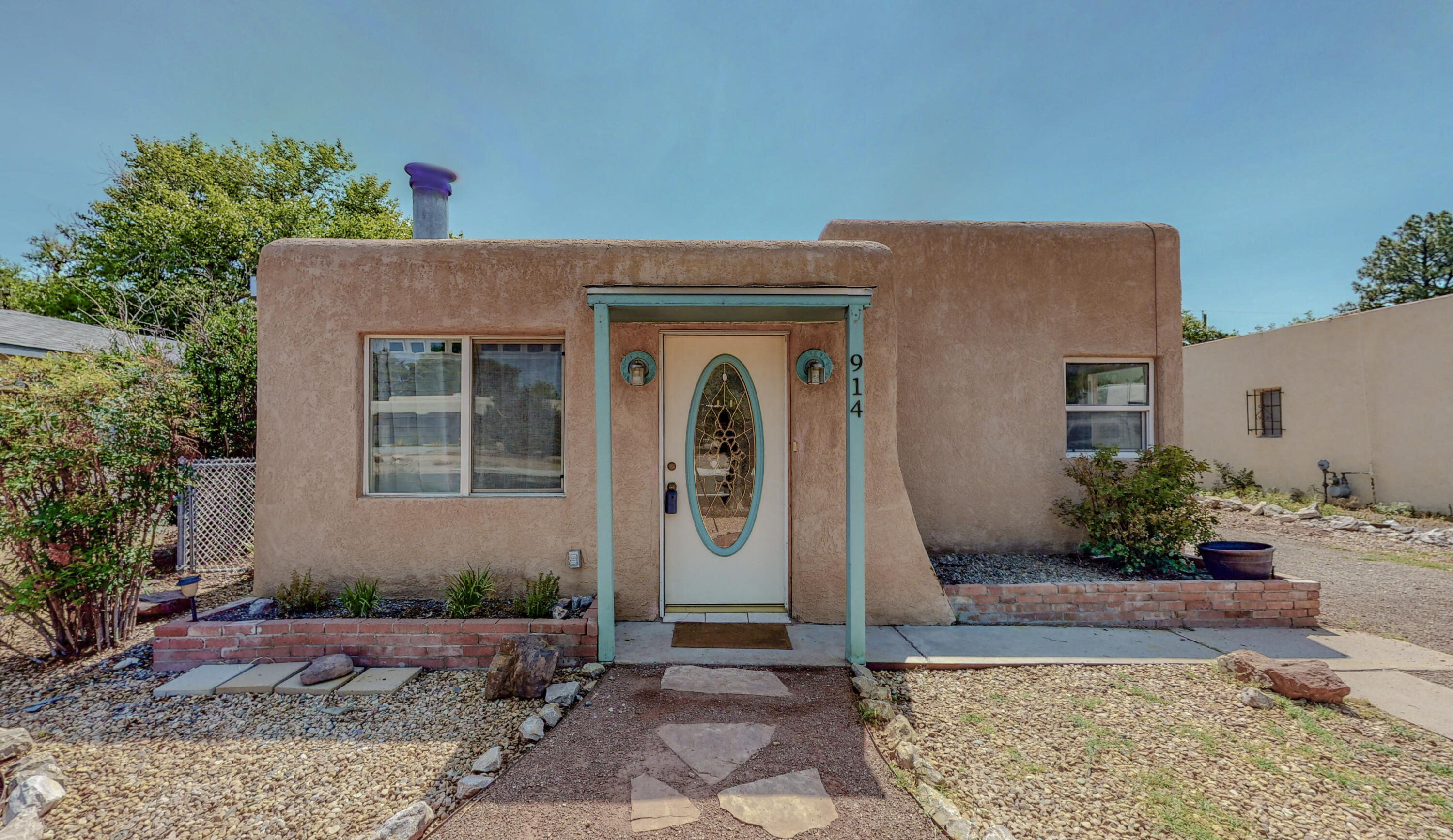 Charming three bedroom home in popular Ridgecrest Addition neighborhood is just what you're looking for!   New flooring added along with fresh paint!  This home includes a beautiful remodeled  bathroom done in 2020.  Complete with generously sized laundry/utility room.  Real wood burning stove for those chilly winter nights. Third bedroom has a separate entrance along with entrance into main home, could also be used as office if needed. Arched entry into dining area.  The property has a large backyard ready for anything!  The neighborhood is well established and the home is conveniently located near KAFB, the VA hospital and Nob Hill.  New roof in 2019.  All appliances stay, including washer and dryer.  This stunning home is light, bright, airy and move-in ready!