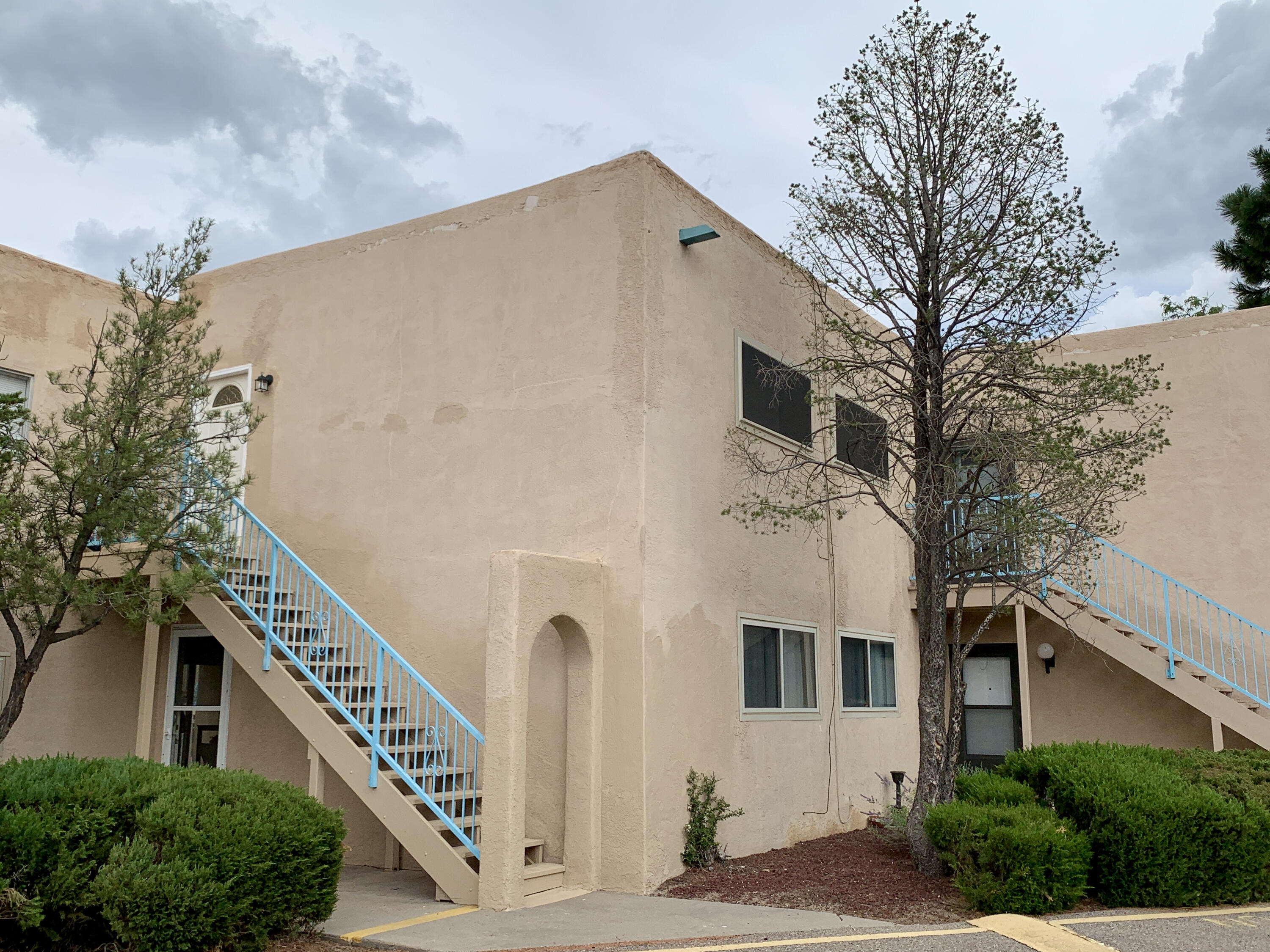 Great 2 Bed, 1 3/4 Bath Condo in a wonderful quiet location with easy access to anywhere in Albuquerque or Rio Rancho. The unit is on the top (second) floor, so one is above you. Enter into the open living room, dining, kitchen, and you are greeted with a wall of windows facing the Sandias opening to a fantastic balcony for balloon viewing. One of the two generous bedrooms has it's own ensuite 3/4 bath. There is a full size washer and dryer in the unit, and those plus the stove, refrigerator, and dishwasher will convey with the sale. There is one carport space just down the stairs across from the unit, and be sure to check out the ample sized locked storage unit marked #4 just in front. New windows were installed in 2019. HOA covers gas, water, exterior of building and grounds. Sweet place