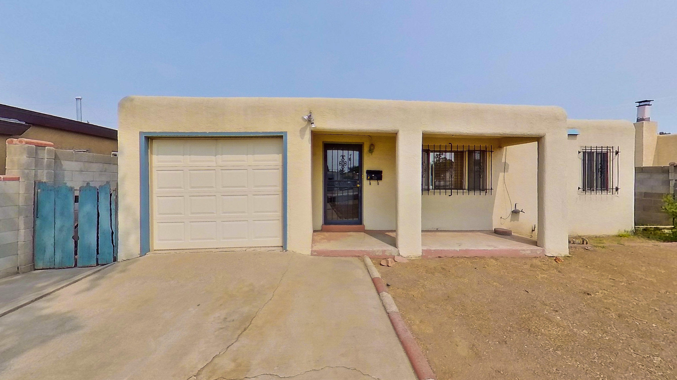 Adorable & Affordable!   Hardwood floors, cove ceilings in living room.  Large front and back yards.