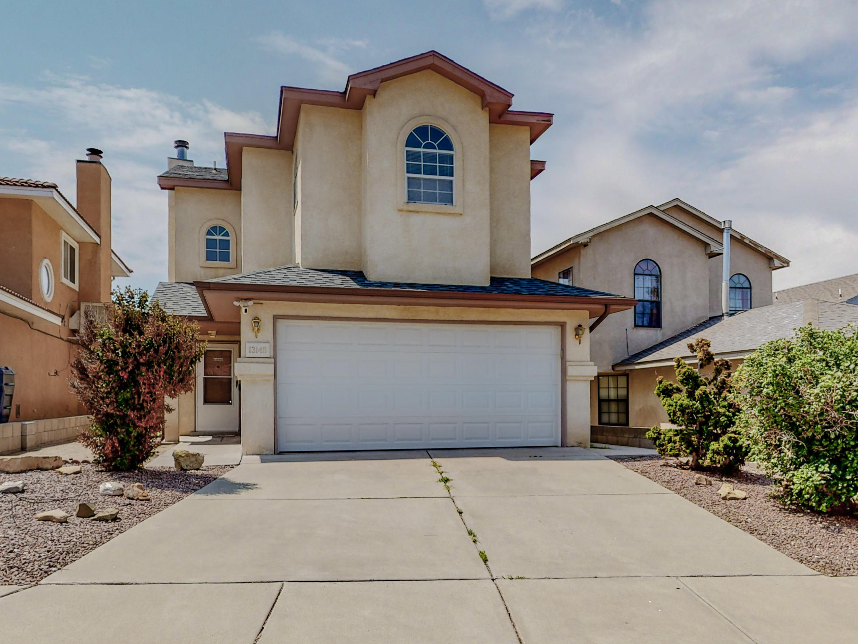 Welcome to this home located in the south  Foothills  with views of the Sandia Mountains! Well maintained 3 Bedrooms and 3 bath Great room opens to kitchen and dining room. Good sized pantry. 1/2 bath and laundry room on main level. Nice sized Primary Suite, full of light and views of the Mountains. 2 Secondary Bedrooms with shared bath. One room has a private  balcony. Garage Door recently replaced.  Block wall in back recently raised for privacy. Low Maintenance Front Yard! Back Yard Is Ready For Your Special Touch!