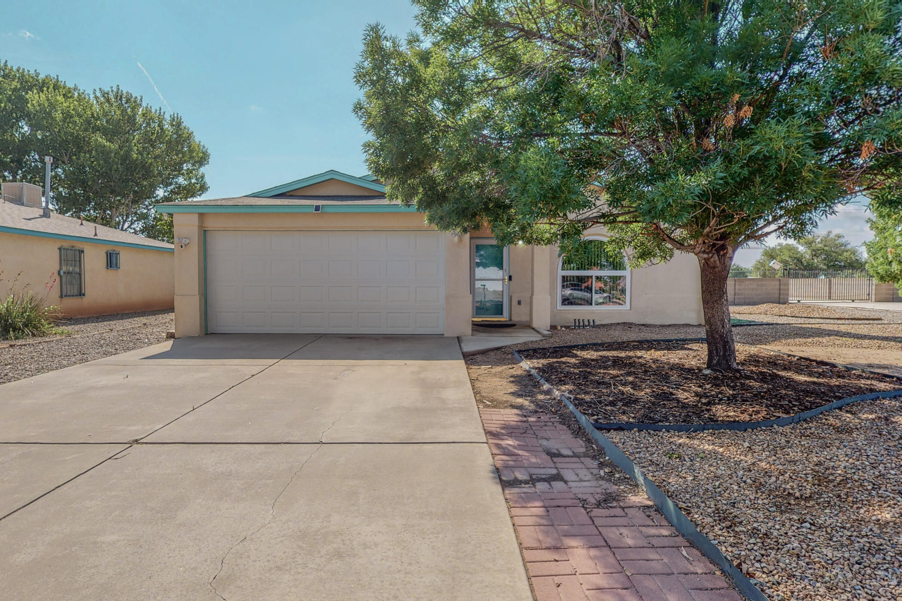 WOW!!! This Home has it all! Designed to meet all your needs and desires in Los Lunas Mountain View Subdivision. Large Open Floor Plan, Handicap Accessible, Updated Bathroom with a Roll in Shower, tile throughout main living areas, Cathedral Ceilings, Walk-In Closets, Refrigerated A/C, Solar Panels (Owned), New Windows, Newer Hot Water Heater and Garage Door. Oversized Lot with Breathtaking Mountain Views, Electric Gate for Backyard Access to a Fully Contained RV Pad with Electric, Water and Sewer Hookup. All appliances convey as well as Ring Camera/Audio. Home is being sold ''As-Is''  Seller will make no repairs. Quiet, family friendly neighborhood, close to shopping and entertainment. Don't wait! Schedule your showing today!