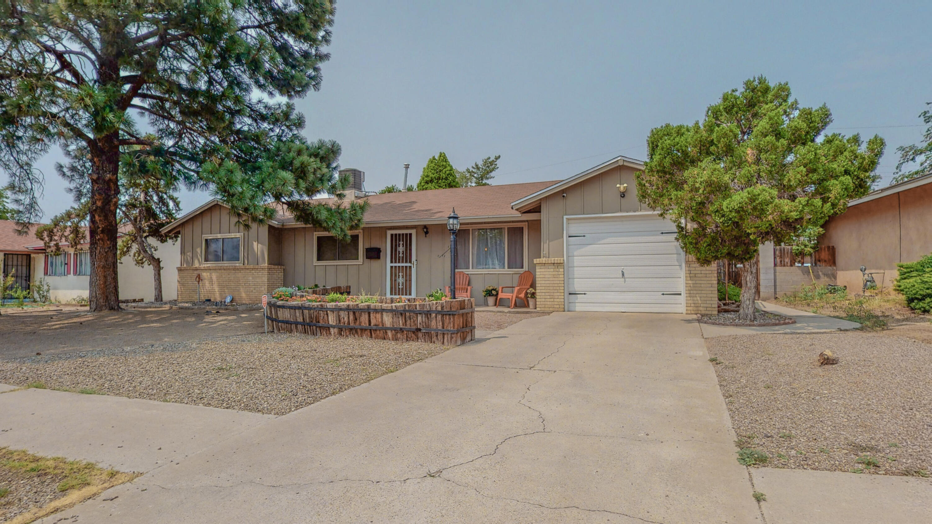 Beautiful NE Heights home located in an established and convenient location. Easy interstate access and close to shopping and restaurants. This home features an open floor plan with lots of natural light. Remodeled kitchen. Bonus 360 square foot addition has endless possibilities (no direct heat) heated by electric fireplaces. This room would be perfect for a family room. Backyard is huge and very private. Storage shed conveys. Home has upgraded refrigerated cooling system and a newer roof. There are bars for all the windows in the garage that will stay if owner wants to replace. Neighborhood park and schools are minutes away. Come take a look...clean and ready for a quick closing.