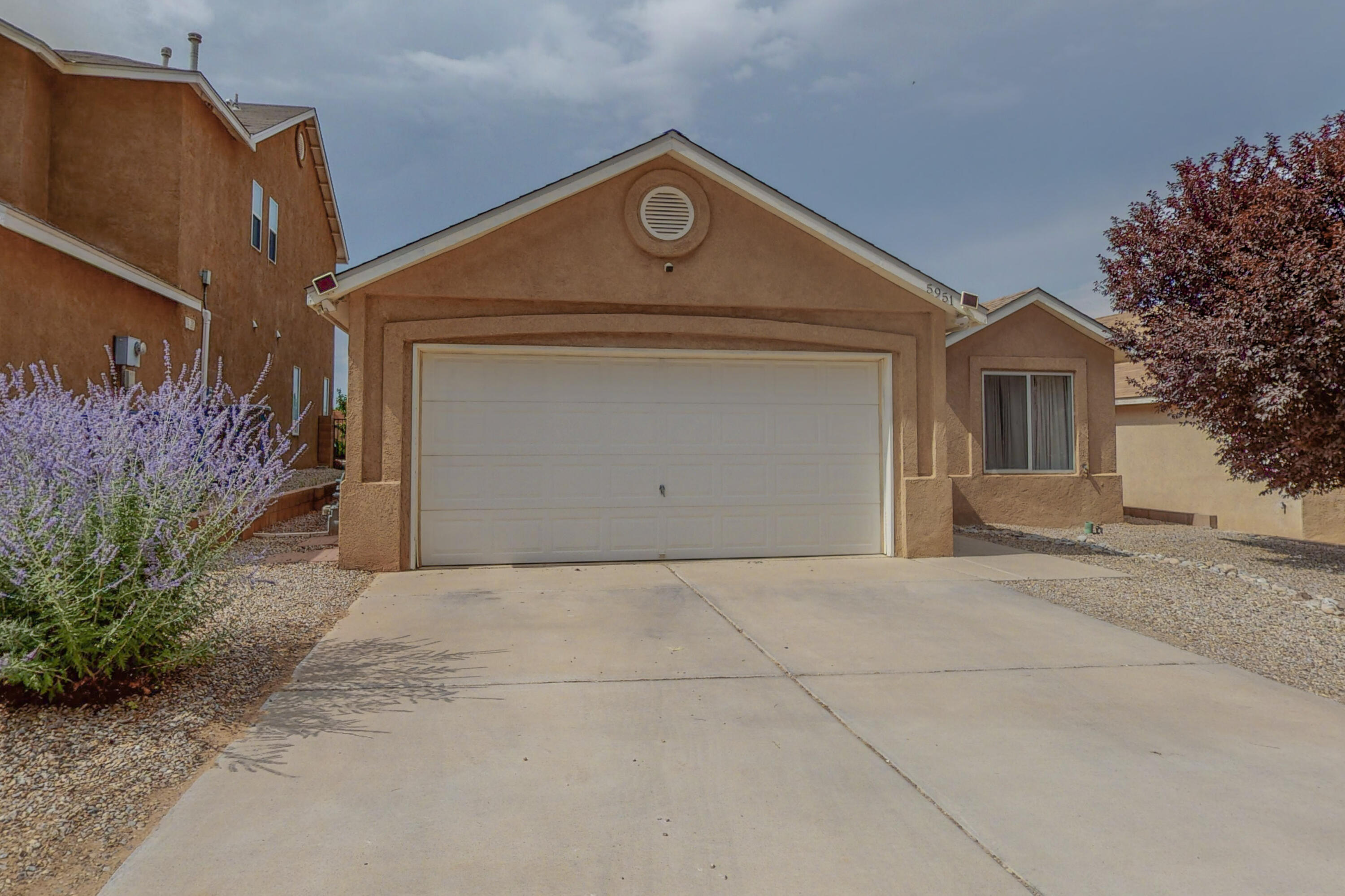 This lovely home located in the Los Suenos subdivision of Albuquerque's Northwest Heights!  Entering this large 3 bedroom home through the front door, you are greeted with a huge, open living area to the right.  Off of the living area in the front of the home through the french doors is the home office or bonus room.  From the front door to the left, you will find the access to the garage and the 2 bedroom, 1 full bathroom private wing of the home.   Going back through the living room towards the back of the home, you will find the large kitchen and dining area complete with all appliances and sliding glass doors to the backyard and covered patio.  Before you get to the kitchen, to the left of the home you will find the master bedroom and en suite boasting custom tile shower and dual sinks