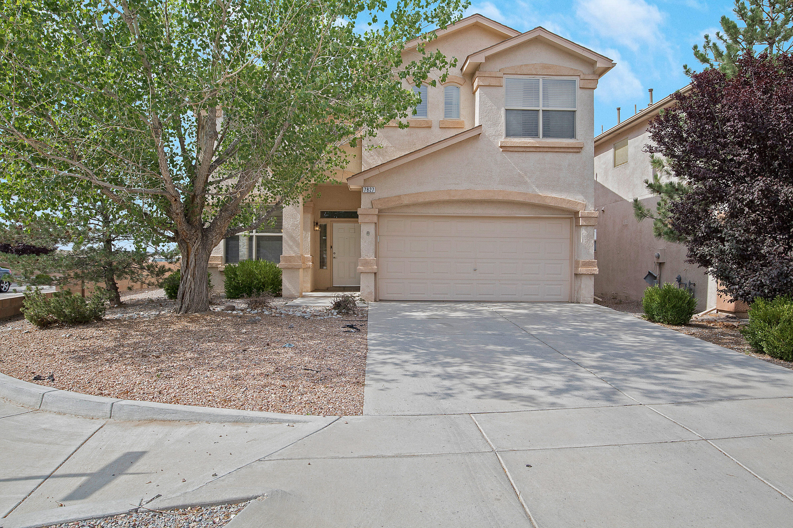 So much space! This spacious home is tucked on a corner lot framed by lovely mature trees. The tile entry opens to a large great room with the versatility to have formal dining as well. The open kitchen has tons of counter space plus an island and is adjacent to a great spot for casual dining. There is an adjacent great family room with a cozy fireplace. Definitely a great gathering spot in the heart of the home.  Don't miss the great storage downstairs cleverly tucked under the stairs plus a full laundry room and a powder room.  Head upstairs to four wonderful bedrooms and yet another living space! The upstairs living area offers many use options plus it opens to a second floor deck with expansive views. The primary bedroom is huge, 228 sq ft plus a full bath and large walk in closet.