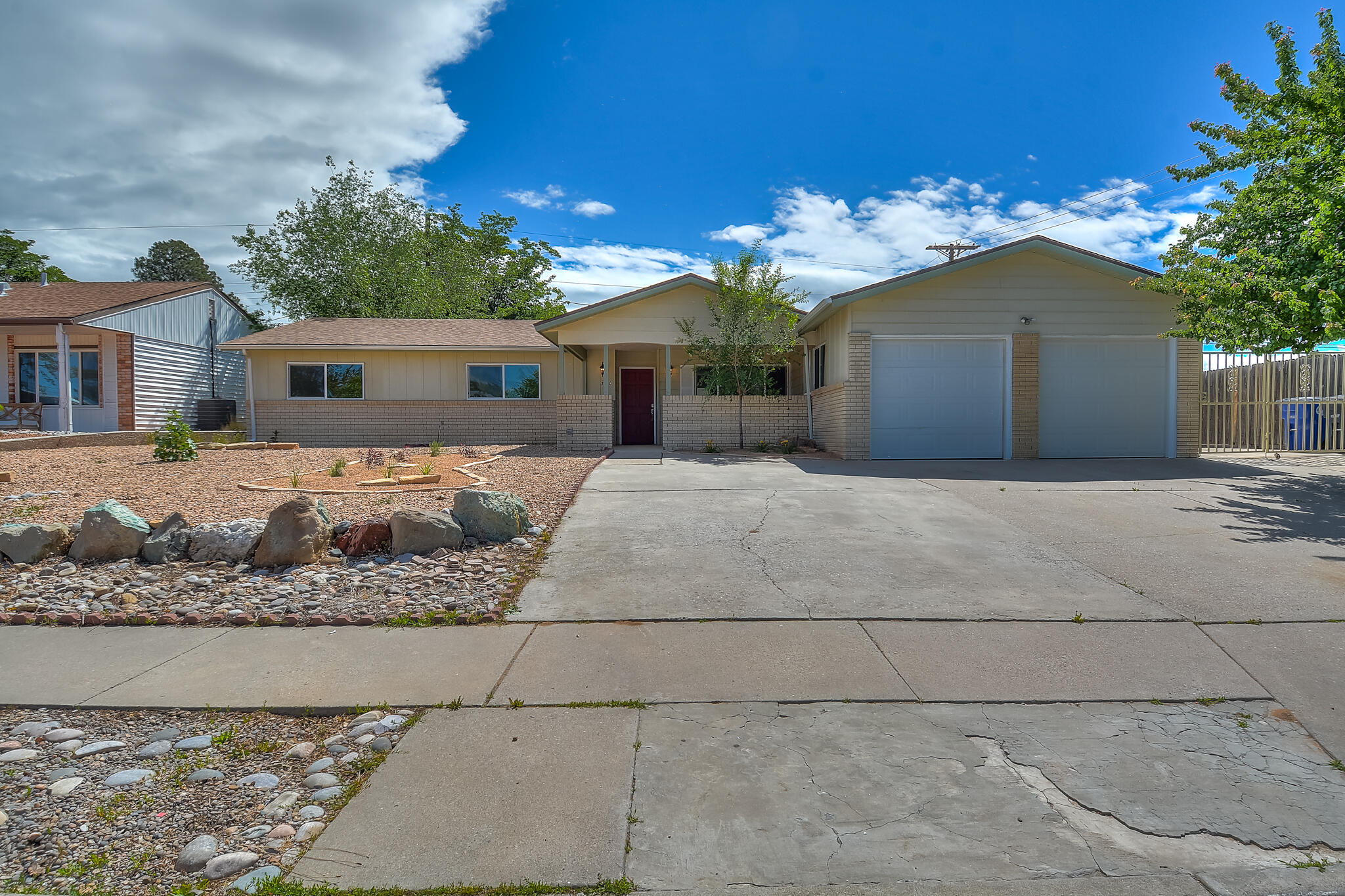 Completely Remodeled Charmer on Large Corner Lot! Come See this Super Clean Well Done Updated Home in The Heart Of Albuquerque.Featuring:New Roof, Newer Dual Pane Windows & Sliders,Newer Carpet in Bedrooms,Newer Tile in Bathrooms,Newer Laminate Bamboo Flooring,Newer Textured and Painted Ceilings,Fresh Paint,Updated Wood Burning Fire Place, Newer Fixtures Throughout and a Two Car Garage.Enlarged Kitchen Includes Newer Cabinets,Beautiful Granite Counters with Tiled Backsplash,Newer Stainless Steel Appliances; a Gas Cooktop/Oven, Microwave,and Dishwasher.This Bright & Open Floor Plan Has 4BR,2BA,Two Spacious Living Areas,& Laundry Room.Master & Hall Bathrooms Received Major Updates Including Custom Tiled Showers.Large Side For RV & Back Yard W/Built In BBQ Pit!All In Desirable School District