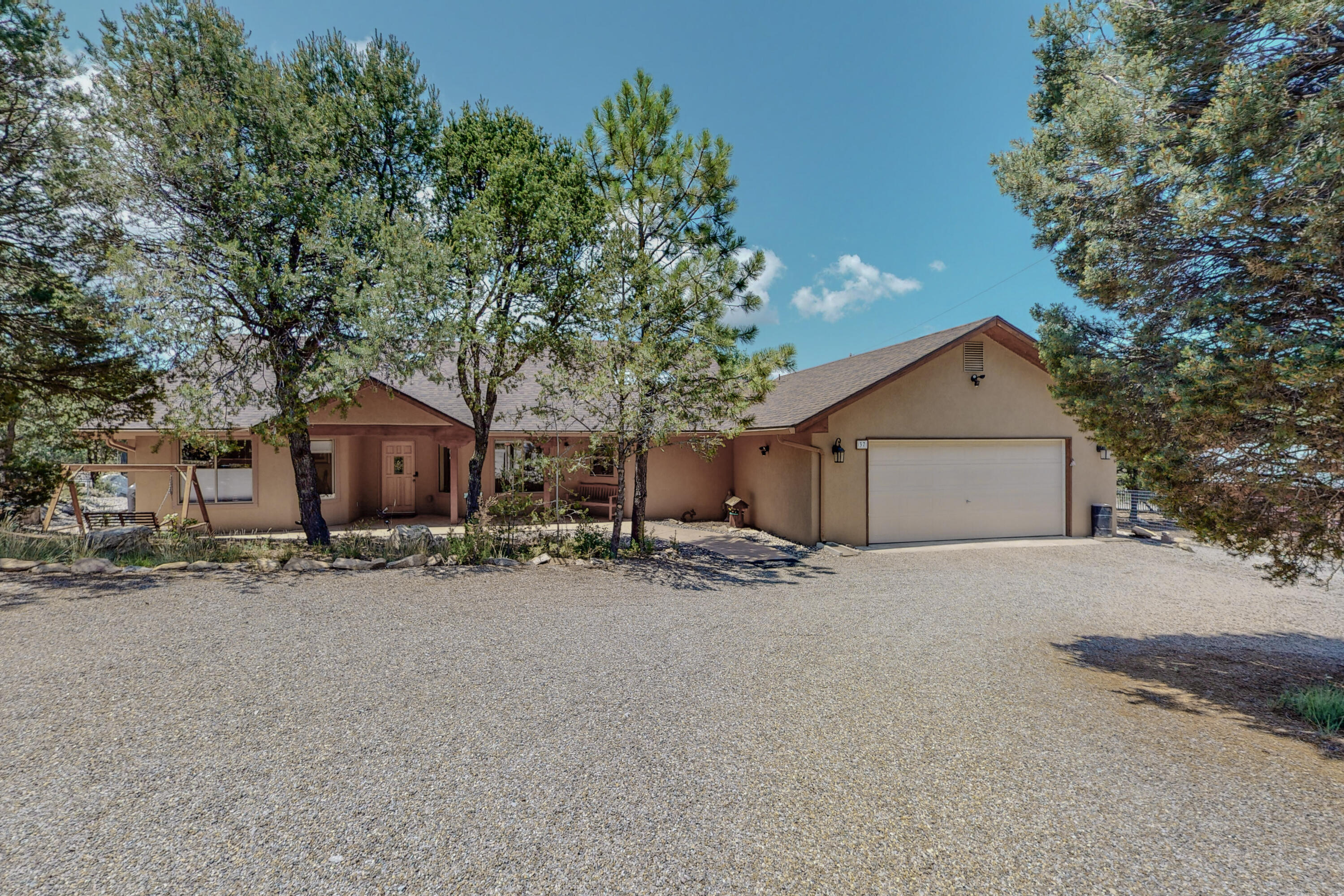Super quality home that has been updated and impeccably maintained.  Covered front porch for relaxing in the shade.  Travertine floors, vaulted ceiling.  Living room has views and a cozy pellet stove.  Country kitchen with granite counter tops, stainless GE appliances , loads of cabinets and a pantry.  Primary bedroom with huge walk in closet, spacious bath with all new fixtures and shower doors, jetted tub, separate shower. Door to back deck and rough in for hot tub. Separate study or home office. Two ample bedrooms on other side with bath. Insulated, finished garage with attic storage a work shop area.  Wooded 2plus acres with maintenance free landscaping.  Covered back deck, large level play area, 16X20 shed. Pipe fencing on the front, gated driveway. RV pad w gate and power