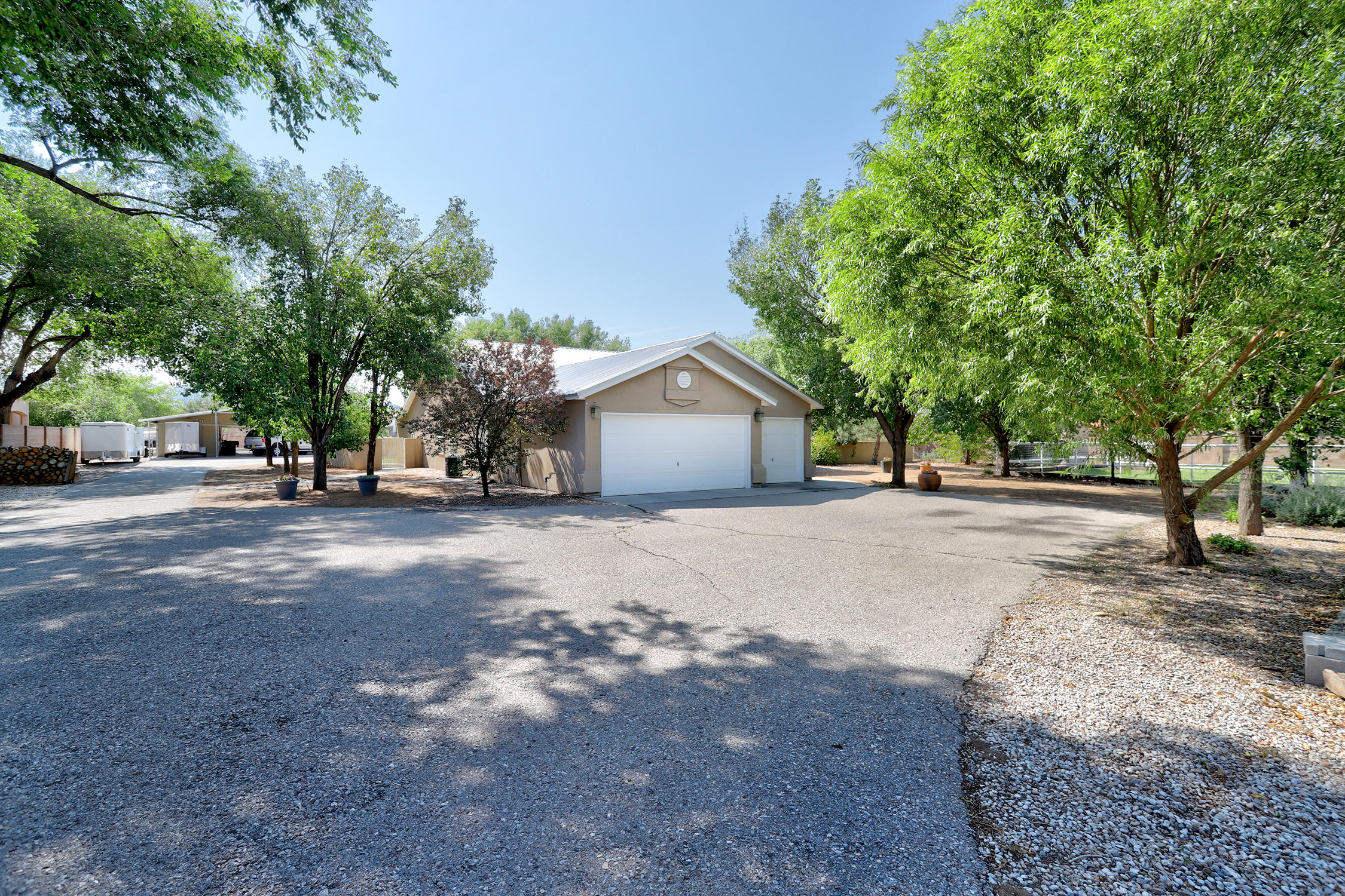 Amazing Horse Property on Two Acres w ditch rights city water and irrigation well with heated and cooled well house. Zoned agriculture. 1 acre of walnut trees  Beautiful pipe fencing gate welcomes you in to the lush property. The barn has 4 stalls, tack room, hay storage and a 1/2 bathroom. Barn opens to the lighted arena. Relax on the covered patio next to the waterfall, and pond. Enjoy the outdoor fireplace on those cool evenings. Foyer enterance opens to oversized dining room and open kitchen. Great room with gas fireplace and built-in bookcases glass door to covered patio. Front office perfect for working from home. Owners retreat boasts walk in closet and beautiful updated bath with dual shower and glass door to backyard. Easy access to walking, bike, and riding trails and Open Space.