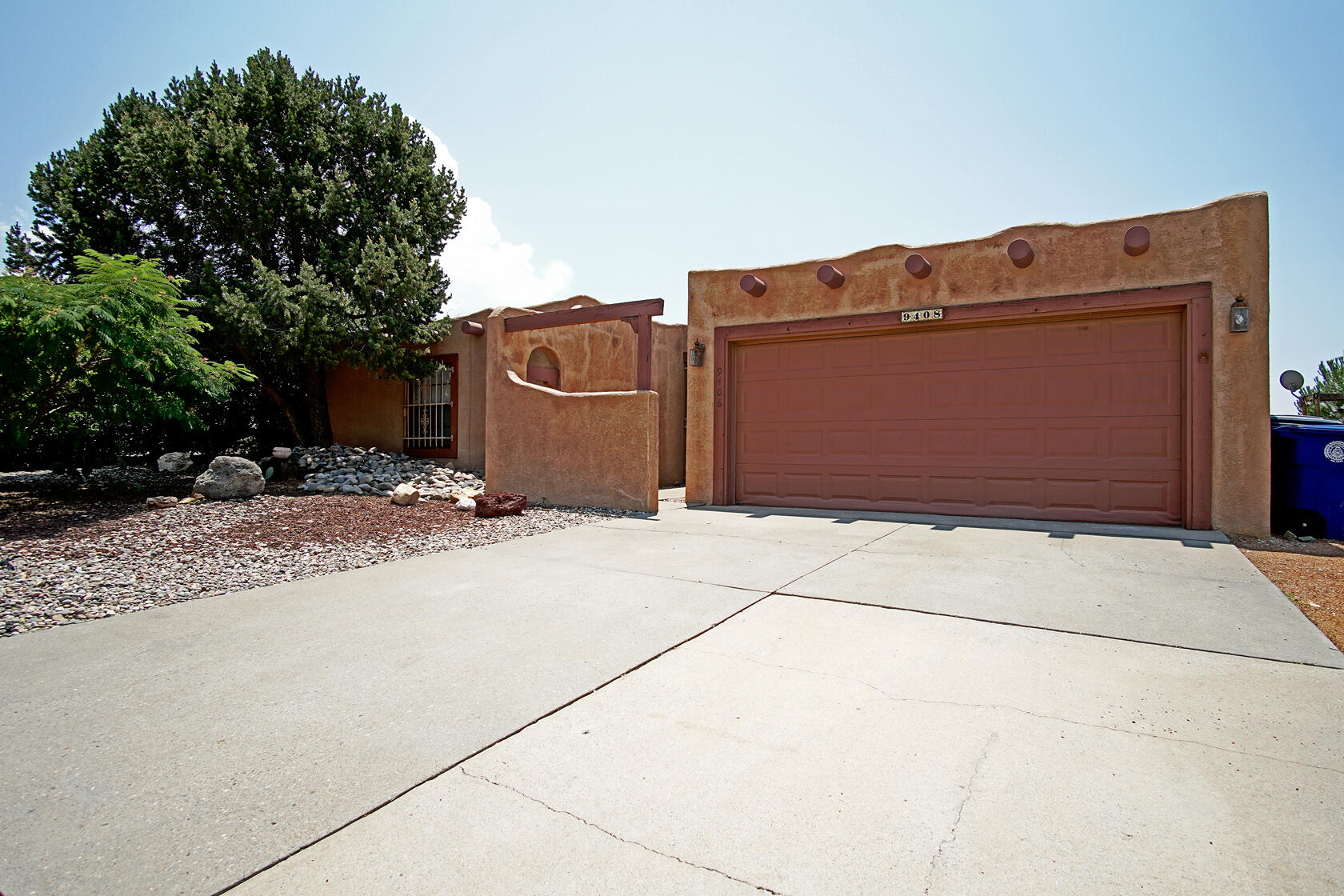 This beautiful Pueblo Style Home offers a warm welcome to authentic New Mexico living! Some unique features of this home are the spacious open floor plan, high ceiling vigas, gorgeous ceramic tile, and a bar-top lounge area. The fireplace in the main living space creates the perfect ambiance with its brick exterior and extended sitting space.  This home also offers a stunning, low- maintenance finished backyard with a combination of xeriscape and artificial turf as well two-storage sheds. Located less than 10 minutes to both I-25 and I-40, this home makes for a very convenient commute to many desirable Albuquerque destinations!