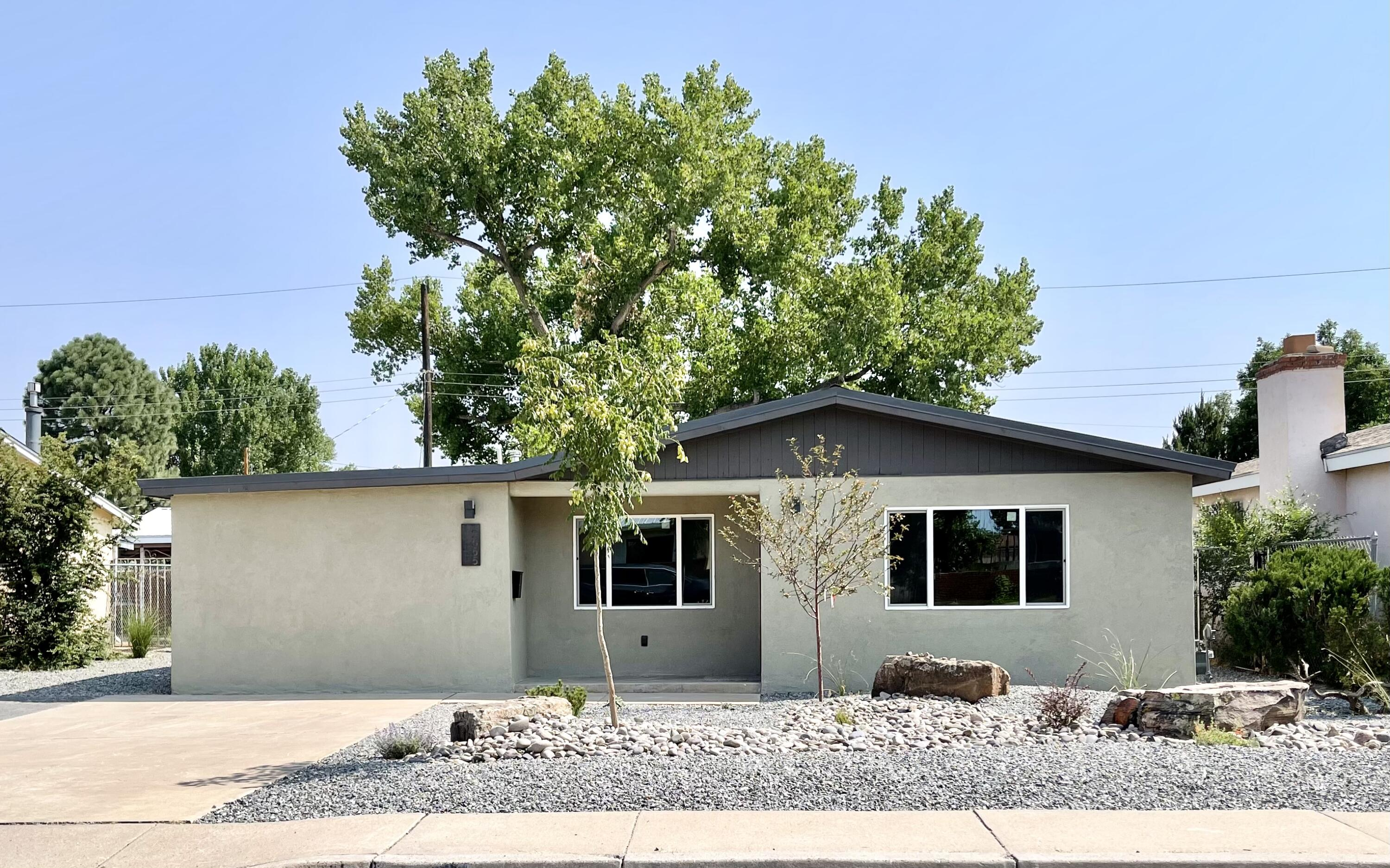 Beautiful Remodeled Home settled near the River in the North Valley. This Home feels like a New Build with everything upgraded. Walk in to this wide open Living room overlooking the Amazing Kitchen that has a Huge Granite counter top with Custom Cabinets that Shine. Lots of Recess lighting that brightens up the room plus Nice Big Windows to bring in natural light. Walk into the Spacious Master suite that has a big walk in closet. The Master bathroom shower is Stunning with the marble tile. New Roof, New Windows, All New Plumbing, All New Electrical wiring, Synthetic Stucco, New Water Heater, New Furnace and so much more. Enough room for an RV/Trailer. Walking distance to the River and Rio Grande nature Center. Close to the Freeway and Old Town and Downtown. You Need to see this House.