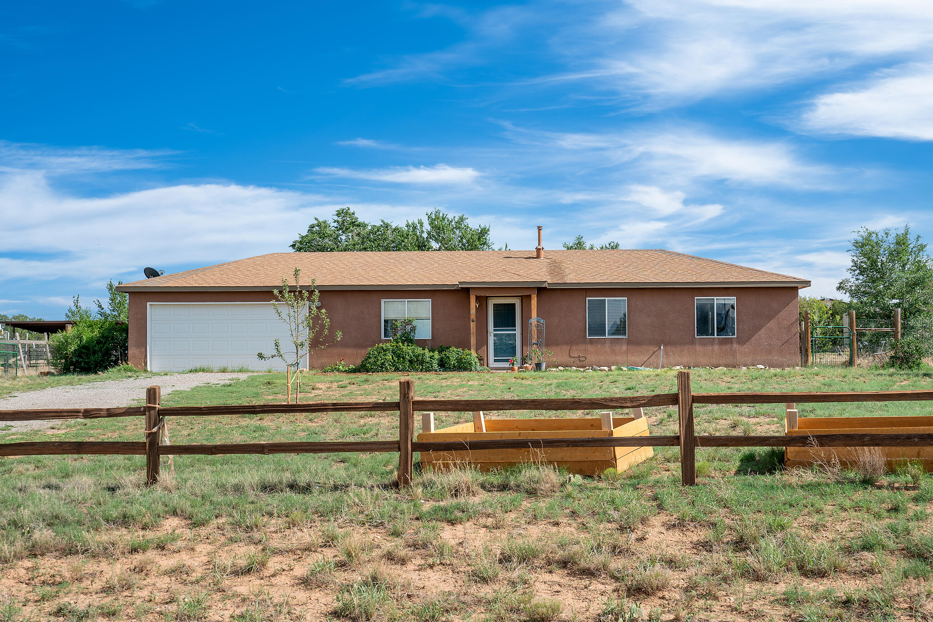 Pride of ownership in this 2 bedroom, 2 full bath home that sits on a fully fenced 1 acre lot. Master bedroom includes spacious walk-in closet. Walk-in pantry and refrigerated air. Beautiful south mountain views. Selling in ''as is'' condition. Shed conveys with property.