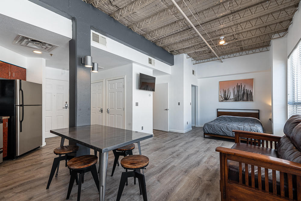 Classic 1930s loft in downtown Albuquerque, this third-floor studio condo has it all. Massive eastern facing windows (bringing in tons of natural light), ultra-high ceilings, vinyl flooring (zero carpet), an oversized bathroom, in-unit laundry, Nest thermostat and smoke detector, and convenient first floor storage unit. Centrally located in downtown, enjoy easy access to nightlife, restaurants, and coffee shops. Head west on Route 66 and hang out in Old Town or head east and be in Nob Hill, whatever you choose to do it'll be close by!