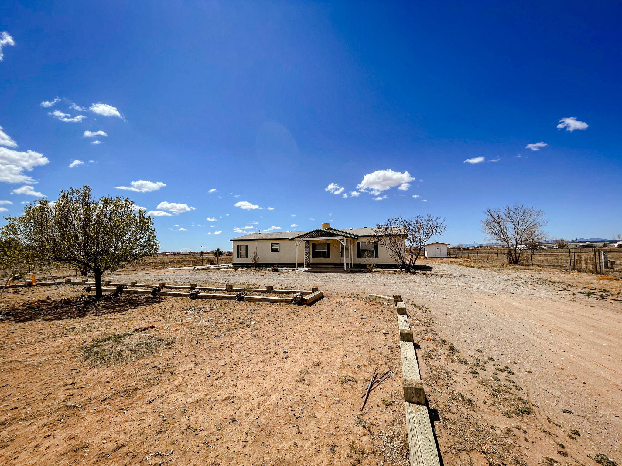 Very nice manufactured home on almost an acre with great views and lots of open space.  New carpet, detached garage and a storage shed.  Easy access to I 40 come take a look.