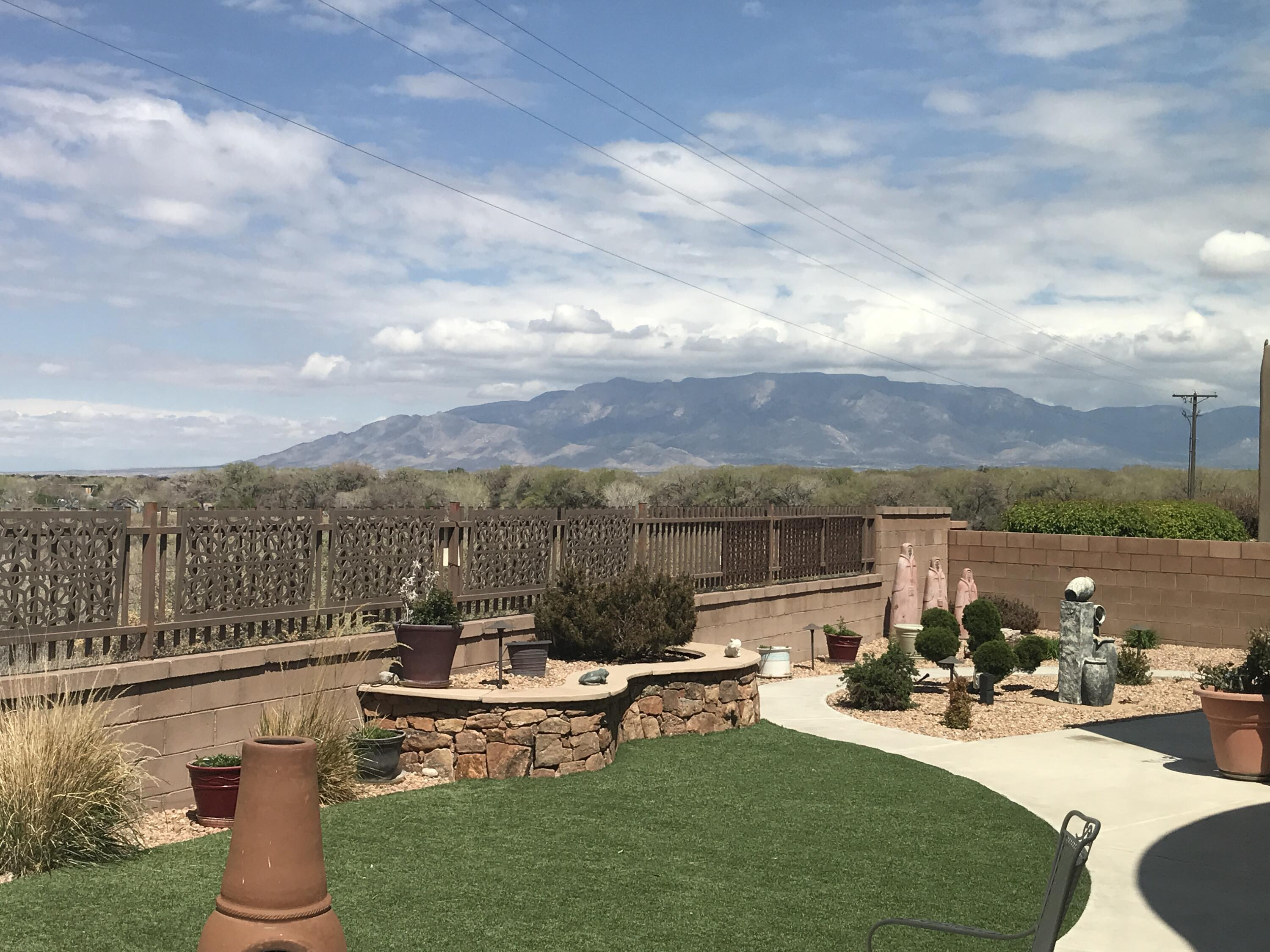 Views Views ! Mountains, Balloons, Sunsets. Backs Bosque Open Space, Walk or Bike. Exclusive El Bosque Gated Area. Easy access to Montano or Coors I/40 -10 min to Dwn Town. Shopping & Eateries Galore. 1 Level Custom, 4 Car Garage w/Loads of Storage & Cabinets. Gourmet Kitchen,2 Pantries, Granite Counters, Lush Dropped Cabinets, Double Oven, Microwave & Gas Cooktop. Top of the line Appliances. Cov/Patio w/ Built-in BBQ, Speakers & Sun Shade. Drip System & Water Feature. Lg Great Room, FP& Raised Ceilings, Wall of Windows/Views.  Decorative Texture & Ventian Plaster. Tile & Carpeted Floors, LG Dramatic Entry. LGBilliard/Family Rm or Formal DR..Pool Table/Cover, TV(Big Screen) & Bar Stools Stay. Master BR/Huge Walk-in Closet. Lg Full Bath. + 3 LG Bedrooms + 2 1/2 Baths. Be sure & click More