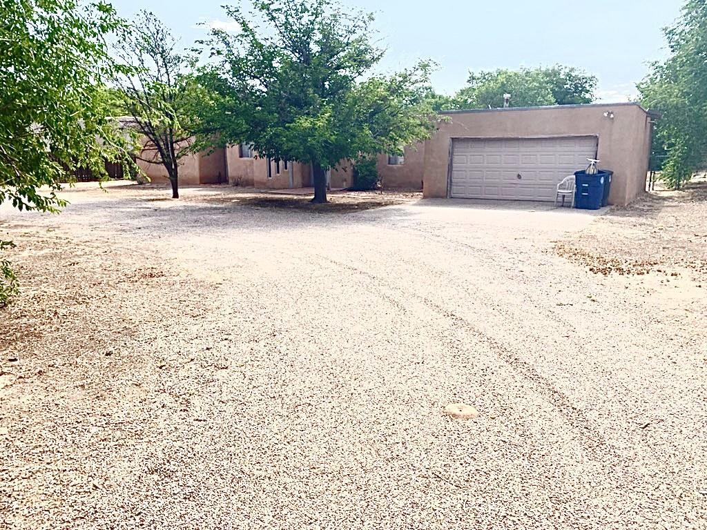 Unique opportunity to own a custom adobe home on a large beautiful lot with trees, space and a Rio Grande address!!  This home was originally the model home, in 1970, for Dietz Farm.  Two car garage, two bedrooms and 1 bath is perfect for retirement or perfect as a starting point to build an amazing home on this large lot!