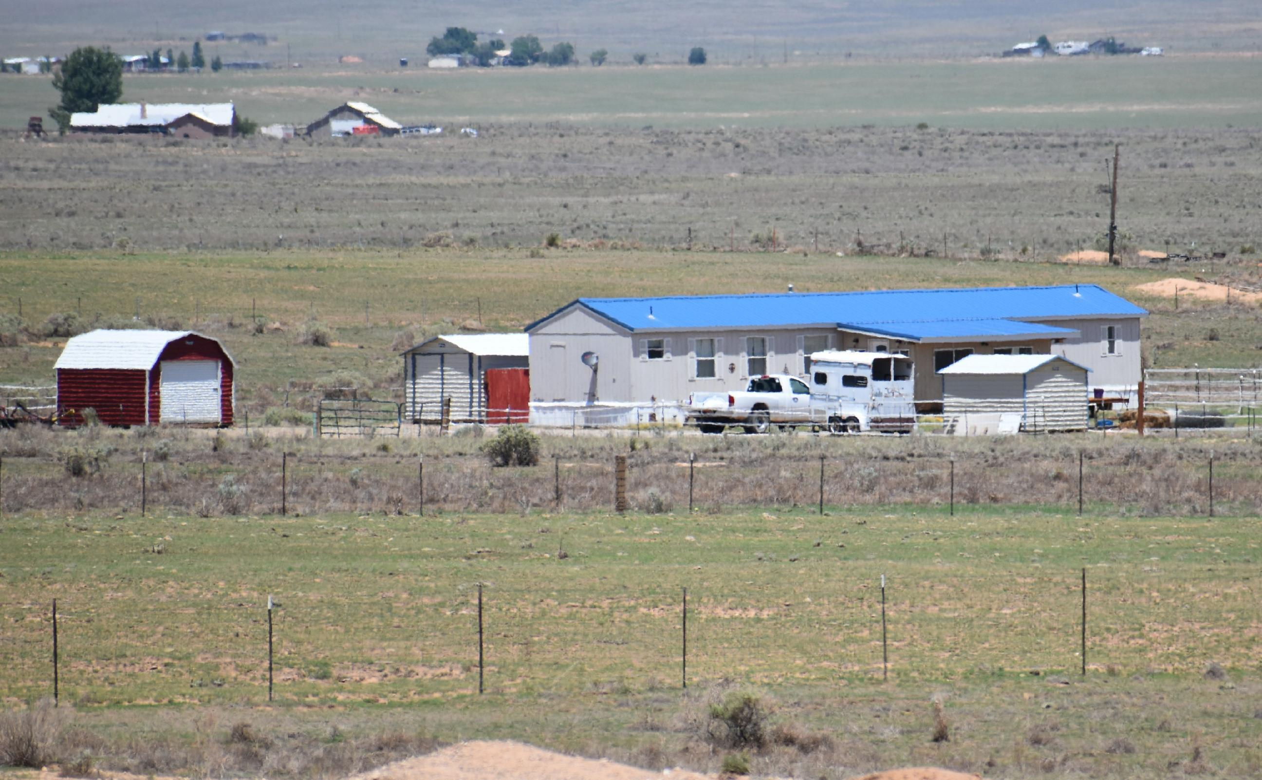 If you are seeking an affordable turnkey horse property, move-in ready, look no further, here it is.  Just under 5 acres, full-size arena, 1440 square foot mfd home with 240 sf add-on, 2-person hot tub, refrigerated air, pellet stove, land fully fenced and cross-fenced, 3 storage outbuildings, 2 barn type outbuildings, power and water at barns, power at arena and 2 of the storage buildings, graveled driveway with two large gates, new window screens in home, several very nicely done upgrades to home interior, acceptable offer can include tractor with disc and mower.