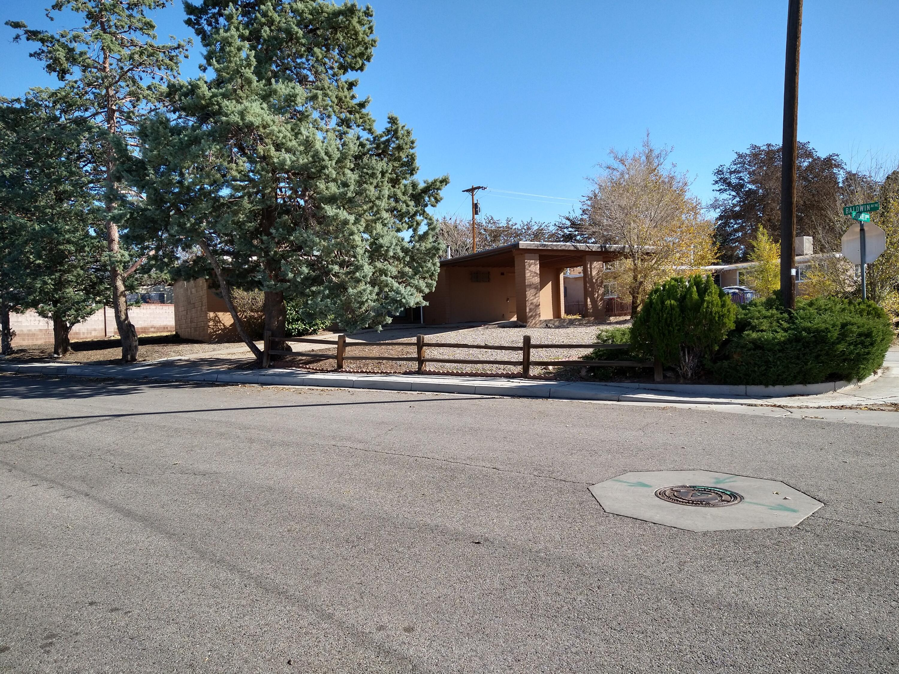 Wonderful starter home, on huge corner lot.  Den with fireplace (could be 4th bedroom).  Large backyard for entertaining.  New windows installed in March.  Lots of potential.  Nice size rooms. Lovely neighborhood. Near schools and bus line. No sign in yard.