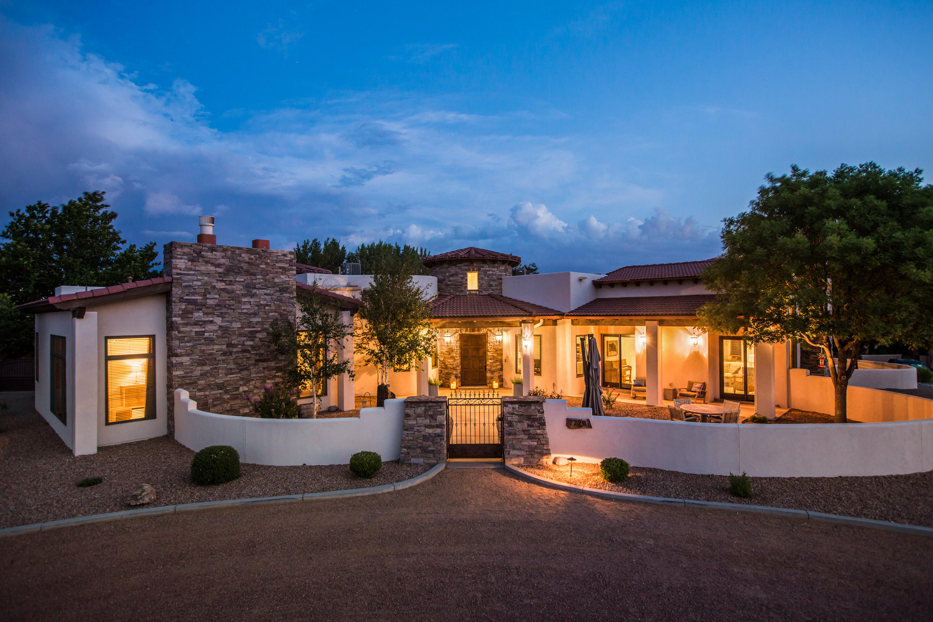 Incredible opportunity for the discerning buyer who desires views and privacy on arguably the most desired street in Albuquerque. Enjoy the beauty of the setting nestled adjacent to the lands of the Pueblo of Sandia, and watch the buffalo roam from your front yard. Beautiful vistas of the Sandia Mountains, the city lights, and events such as the Balloon Fiesta and 4th of July fireworks can be enjoyed from the living areas, master suite, and outdoor living spaces. Beautiful attention to detail define this incredible custom built home. Inspired by the architecture of Santa Barbara, this home is beautifully appointed with high end finishes and beautiful design. Backyard is an oasis with lush landscaping, a sparkling pool w/slide, hot tub, outdoor shower, and great outdoor living spaces!