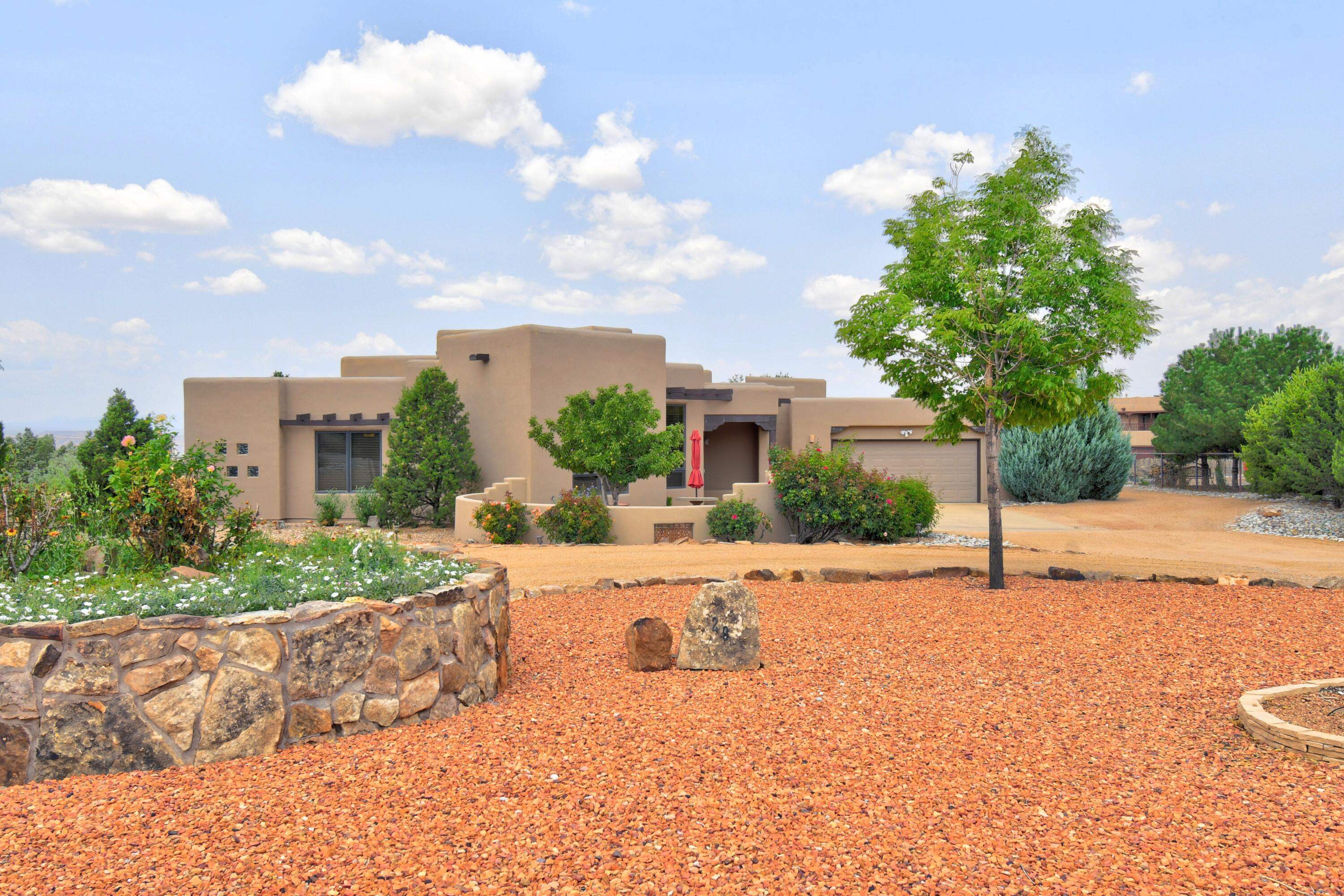 Exceptional custom home with fabulous west mesa and Sandia Mountain views. Watch beautiful New Mexico sunsets from the living room, primary bedroom and bathroom. Manicured professional landscaping front and back that includes a custom seated fire pit and all kinds of hardscape details. The interior boasts designer paint, ceilings and lighted niches throughout. The kitchen has granite countertops, built-in stainless steel appliances and a walk-in pantry. The living room has high ceilings with beams, built-in shelves and a fantastic custom kiva fireplace. It overlooks the covered patio and impressive outdoor views. Granite countertops, custom cabinetry, round jetted tub and lots of tile make the spacious bathroom a dream. Tankless water heater and water softener. Just minutes to I-25!