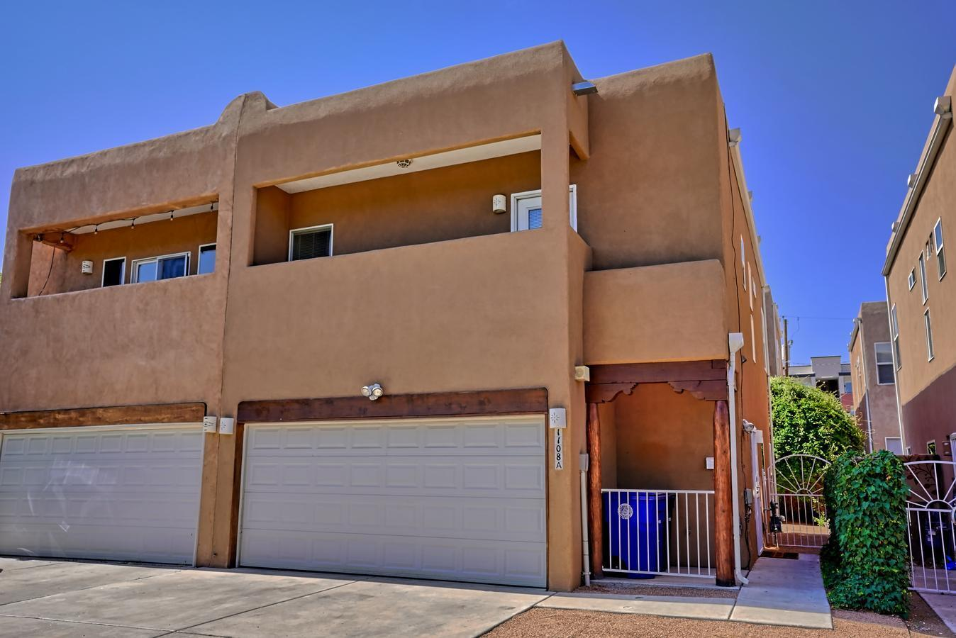 Hard to find in UNM area ~ fantastic light and bright townhome ... 3 bedrooms (huge primary bedroom-with great walk-in closet), 2.5 baths, 2 car garage built in 2004.  Open floor plan with tile flooring throughout downstairs.  Tons of updates!  New paint & carpet (6/21); New Stainless Appliances (7/21); Refrigerated Air (combo unit) replaced (10/20;) ; New Roof & Skylights (10/18);  New Washer & Dryer  (11/17); New Water Htr  (7/17); New Stucco (10/15) and more.  Walk to UNM, UNMH, and Pres Hospital.  Two minute walk to beautiful Spruce Park. . . It's sparkly clean, cute, and ready for a new owner.   A great place to call home!