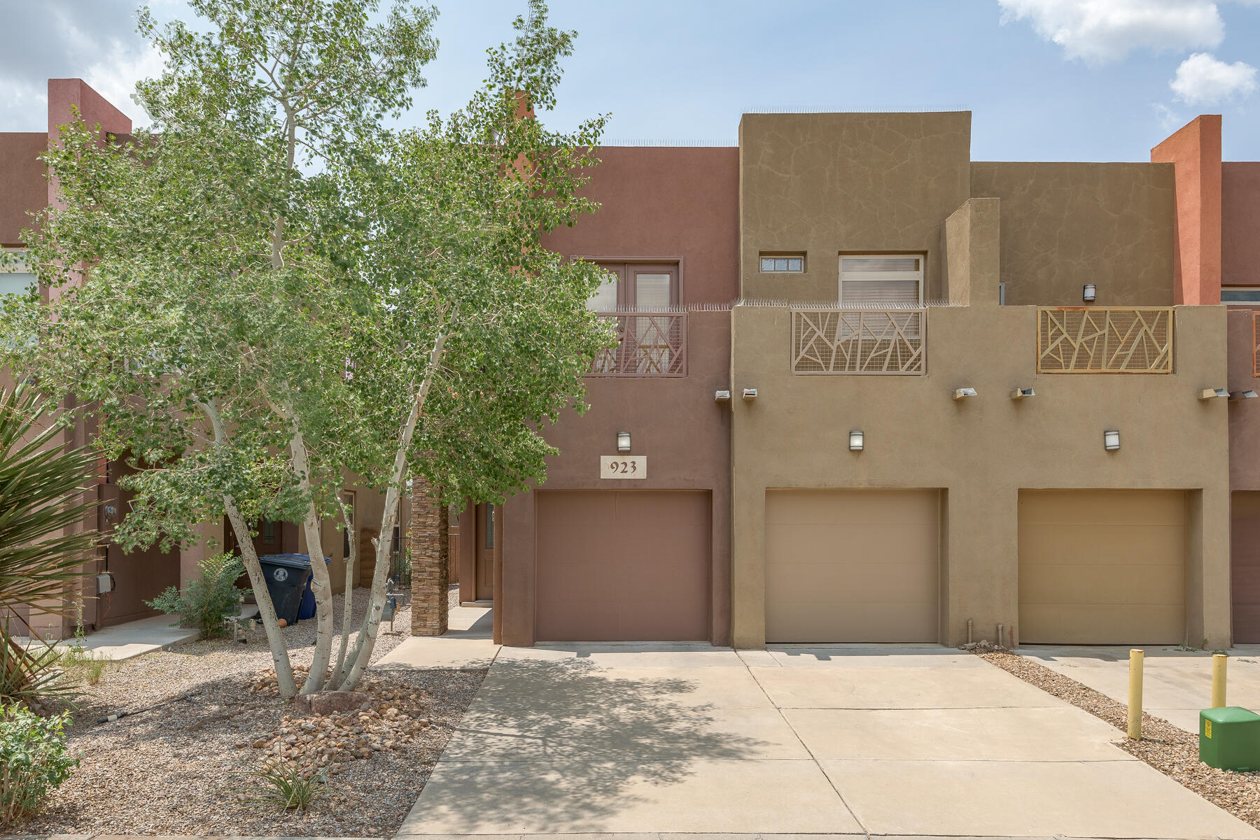 Sophisticated and artistic luxury townhome in a convenient NE location close to the freeway, military base, and shopping. Freshly painted interior, refrigerated air, two car garage, ready for move-in! Open kitchen with granite counters, tile floors, stainless appliances, and eat-in dining area with a door leading to the quaint backyard with covered patio. Cozy gas fireplace, decorative nichos, laundry room with washer and dryer, and convenient downstairs half bathroom. Spacious loft upstairs with a balcony to the west. Huge master bedroom with walk in closet, east facing balcony with mountain view, and gorgeous bathroom with jetted tub, separate shower and double sinks. Ceiling fans, upgraded two inch blinds, decorative tile, and much more!
