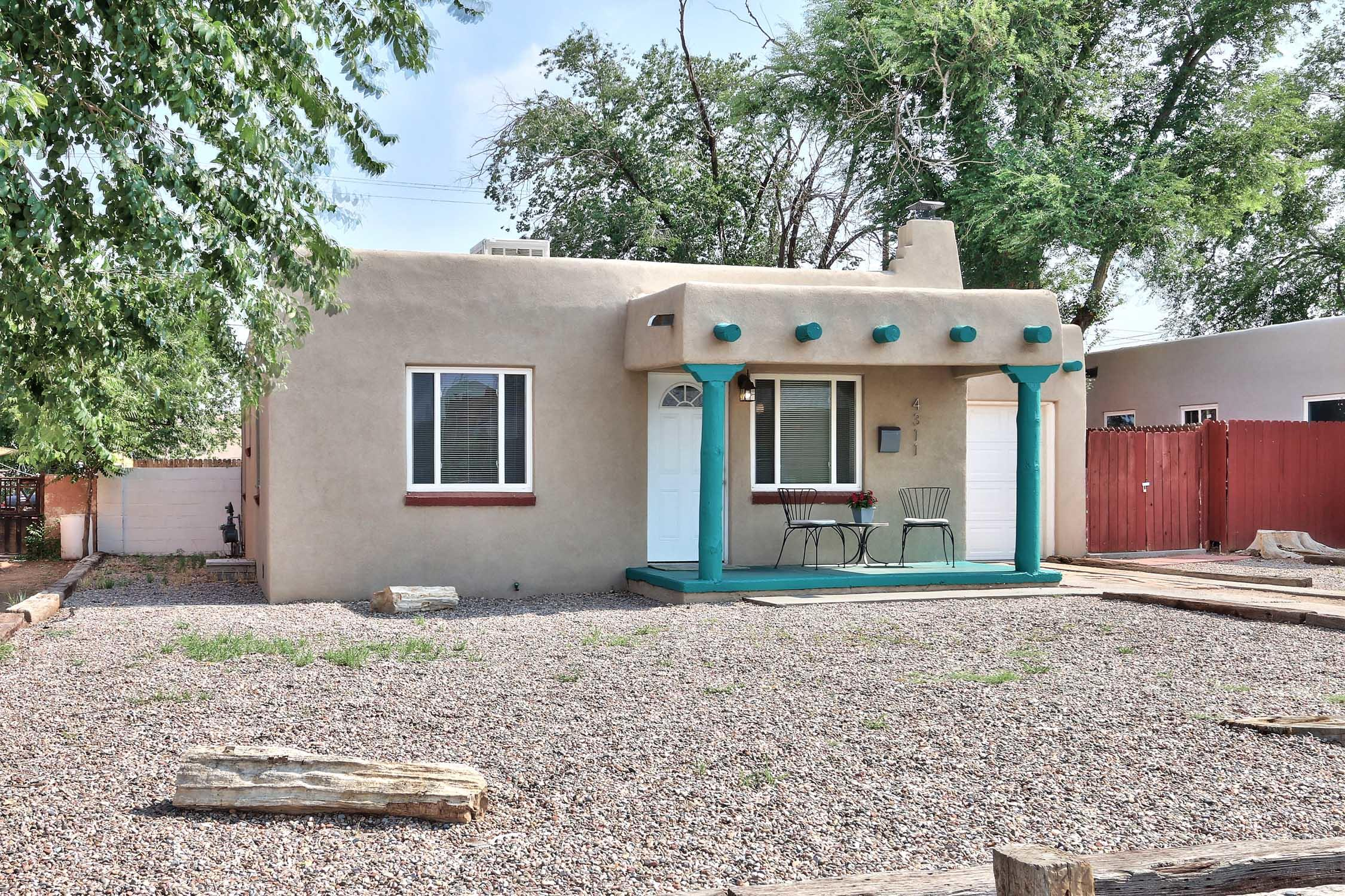 Darling, light-filled UNM area home with hardwood floors and upgraded kitchen featuring granite countertops, stainless steel appliances, modern white cabinetry and ample storage.  Beautiful tile and hardwood floors -- no carpet. 2017-2018 improvements include new TPO roof, new electrical, new breaker box, new evaporative cooler, new synthetic stucco and new windows. Large backyard with storage shed for your tools and toys. A true charmer at an affordable price close to all amenities, including UNM, Nob Hill, medical facilities and more.