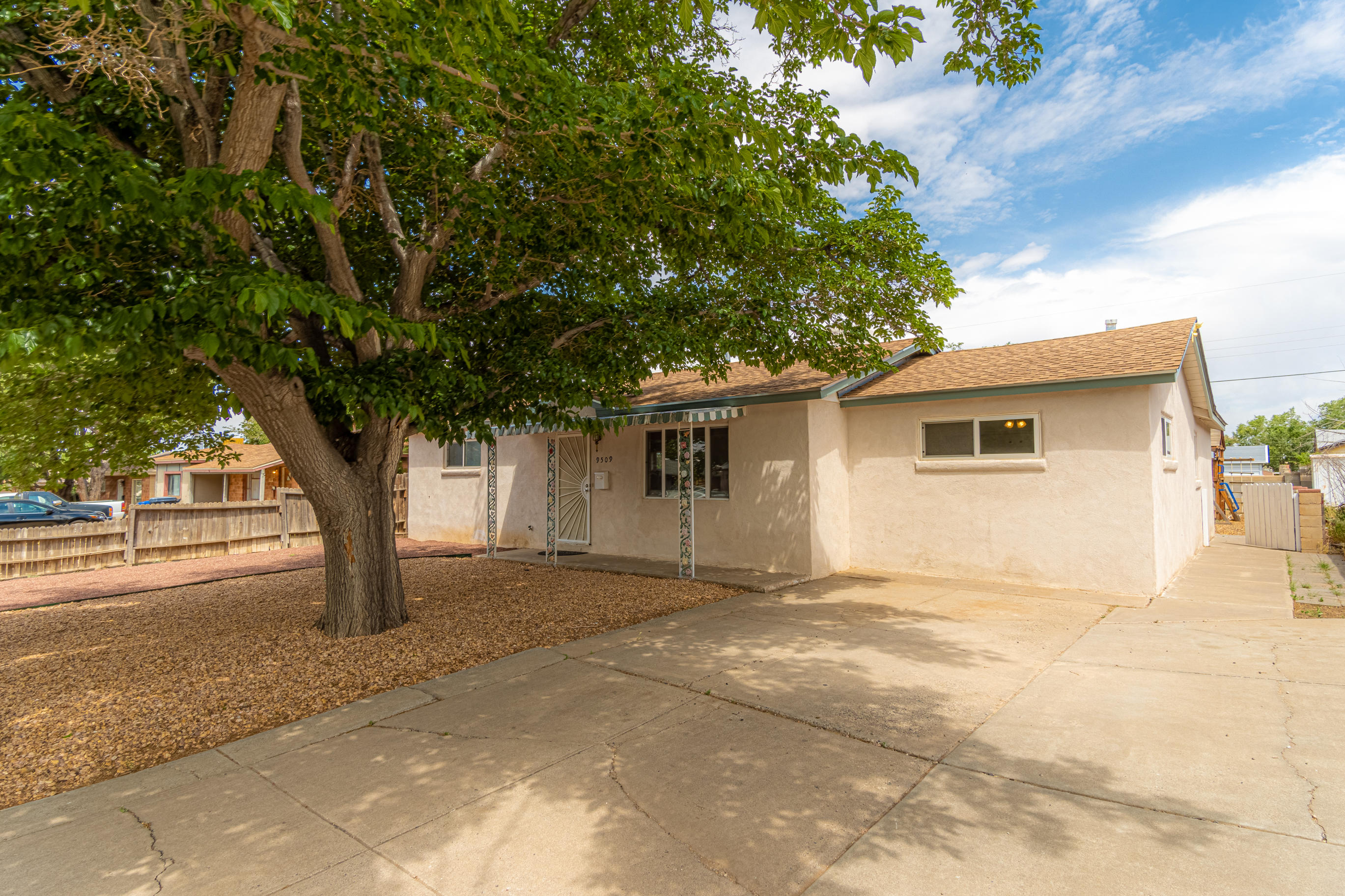Nicely Updated, Move-In Ready, Popular NE Heights Neighborhood! 3 BR's + LR + dining area/office and large service room w/ storage and access to backyard. Owner has lovingly improved this property, brand new eat-in kitchen w/ granite counters; updated bath, pretty vinyl flooring throughout, newer windows, furnace, water heater, cooler, and roof. Good sized backyard has covered porch and ample room to play/entertain/relax. Sandia HS district. Shows Great!