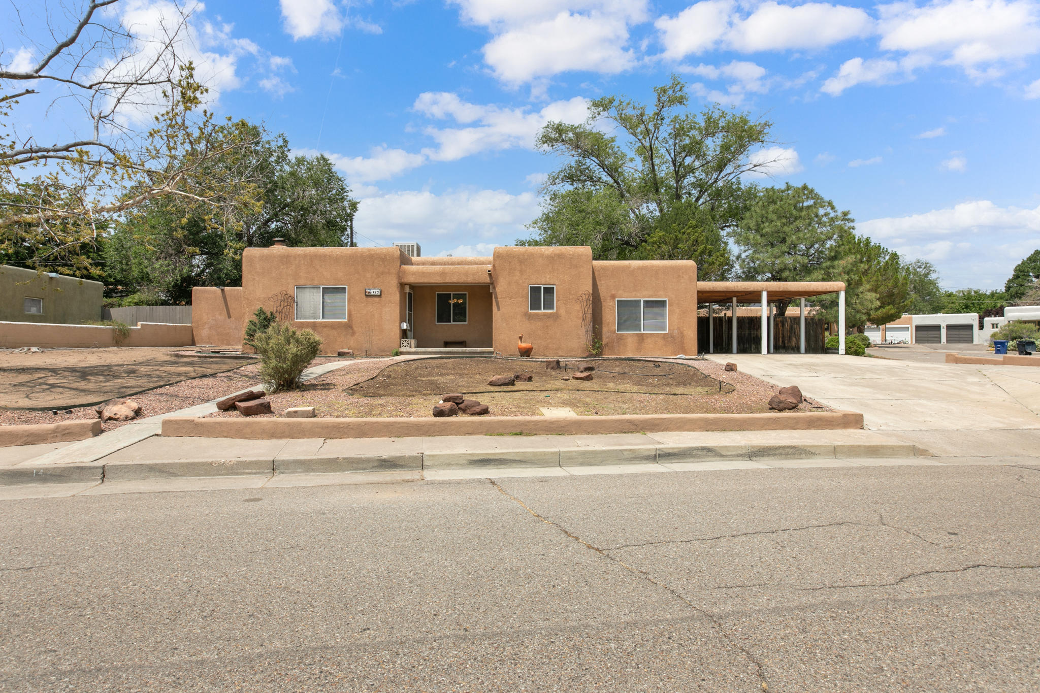 Single story charmer near UNM North Campus is awaiting its new owner. The 4 bedroom property offers beautiful floors; wood, parquet & tile! Amenities include; roof replacement on the house in 2020,updated windows,alarm,two evaporative coolers,two furnaces, two wall heaters and a fireplace. The living area & dining room flow together and offer a spacious area to entertain in. The eat in kitchen offers solid surface countertops,double ovens,cooktop stove,dishwasher and refrigerator conveys with an acceptable offer. The master bedroom is privately tucked away and it is generous in size.The fourth bedroom can easily be used as a bedroom,second living space,office or studio.  You're sure to enjoy the private courtyard area and large back yard that boasts a covered porch and raised garden area.