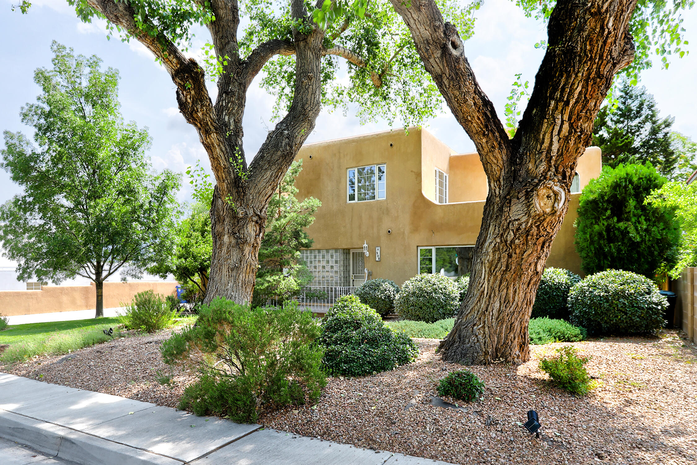 Summer Paradise! Quintesssential Ridgecrest Estate in the heart of the nieghborhood with Pool. So much space featuring generous sized rooms flooded with light. Everywhere find exquisite details like gleaming hardwood floors, cove ceilings and wainscotting. All kept in great condition while updating the right things like windows and AC! 17 Solar panels.5 luxurious bedrooms, 2 1/2 baths. large elegant living room with gas fireplace. Formal dining with french doors to Backyard. And what a backyard-it's a summer oasis with recent resurfaced pool, & covered patio.. Kitchen has huge island and tons of storage. Upstairs deck has views of the Sandias.  Wood burning fireplace in 5th bedroom/office. Detached 2 car oversized garage,. Fully landscaped with sprinklers & bubblers. Simply a gem come see!