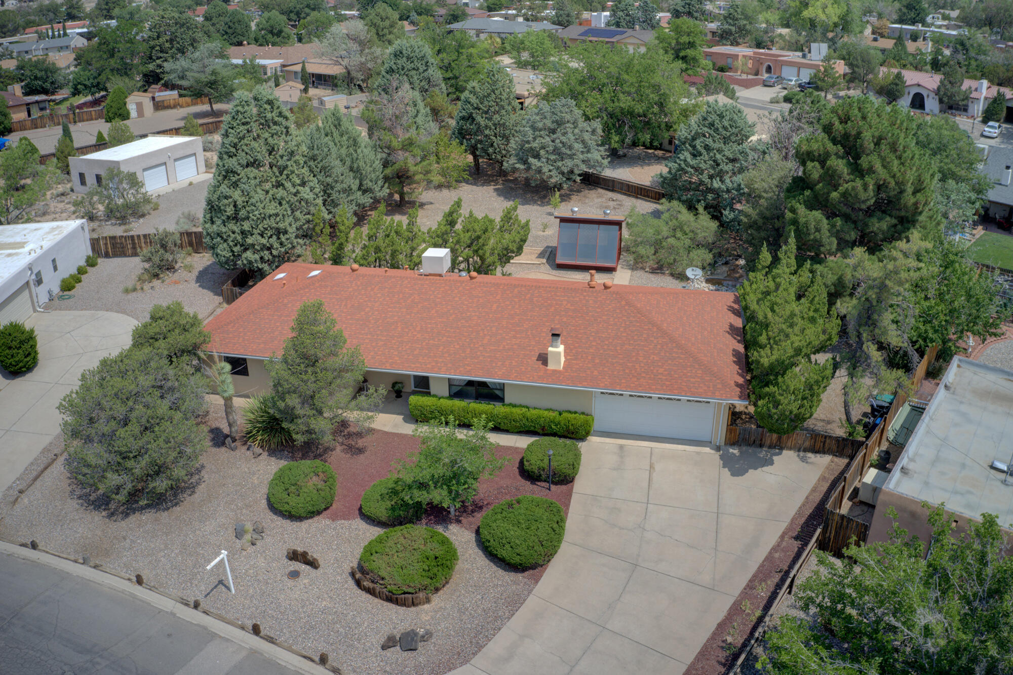 *****MULTIPLE OFFERS****** INCOMING OFFERS MUST BE SUBMITTED BY 5pm 7/25/21. Immaculate home that sits on a very private and serene 1/2 acre lot with a custom 12 x 10 green house and plenty of room for a garden. Relax and enjoy the outdoors while sitting next to the pond and firepit. Newer roof and skylights, Re-stuccoed 2 years ago, Pellet stove for cold wintery nights. Beautiful oak flooring, new carpet, updated kitchen and Baths.  Conveniently located at 528 and Southern. Floor Plan has been ordered to verify the square footage.