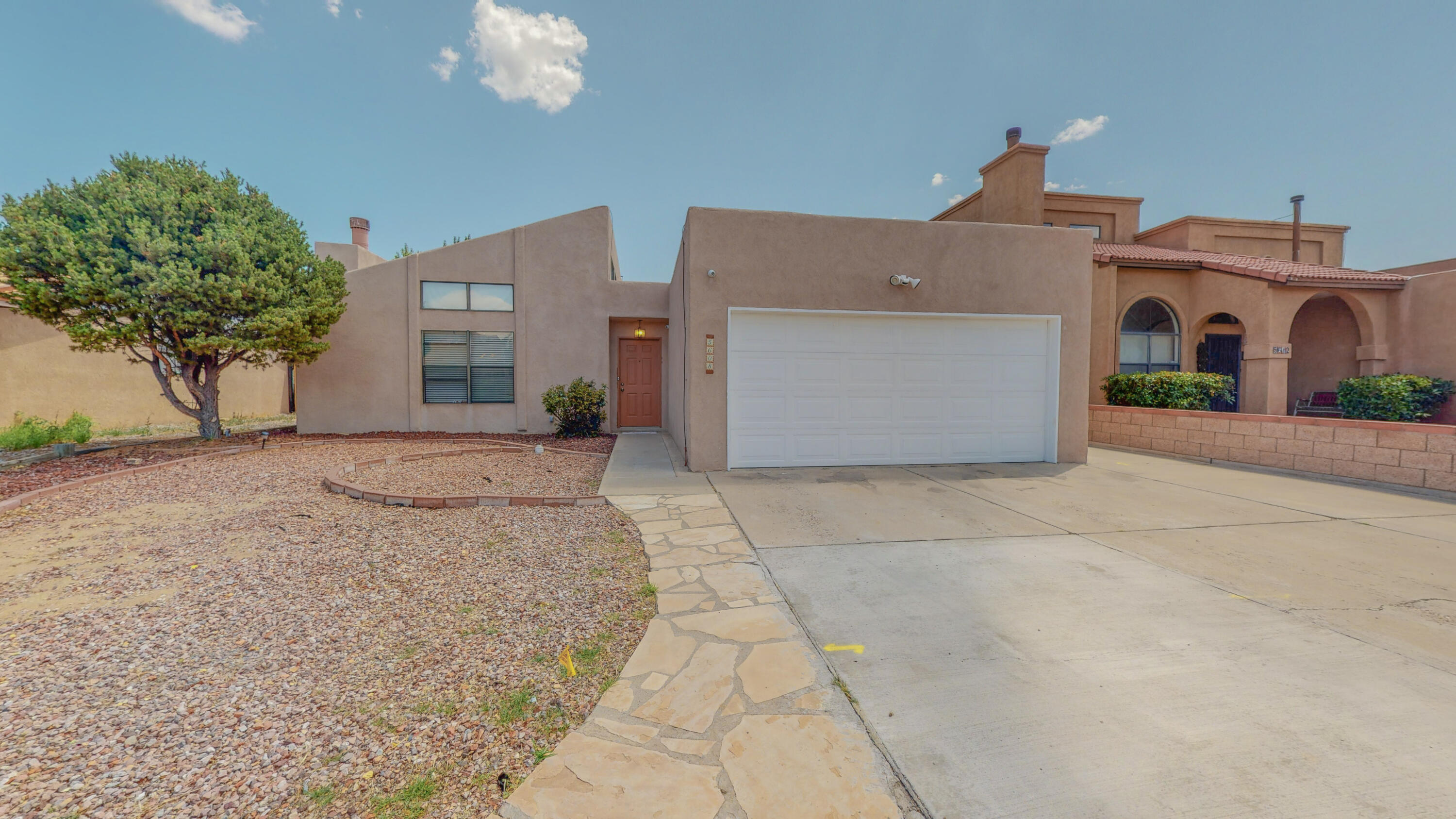 Well taken care of and updated home in the popular Taylor Ranch area of Albuquerque's Northwest Heights. This Single Story home features a bright, open floor plan with three Bedrooms, 1.75 Bathrooms and a 2 Car Garage. The home is highlighted by a Living Room with a wood burning fireplace, 16'' travertine tiled floors, built in surround sound speakers and a Ceiling fan with light kit. The Dining area has a door that opens to the Rear Covered Patio. The Kitchen has upgraded appliances, upgraded plumbing fixtures, upgraded Travertine tiled floors and counter tops. The counters have tiled back splash. The Kitchen cabinetry has all been upgraded. All Bedrooms have Ceiling Fans with light kits. All interior doors are raised panel doors. Family friendly back yard with