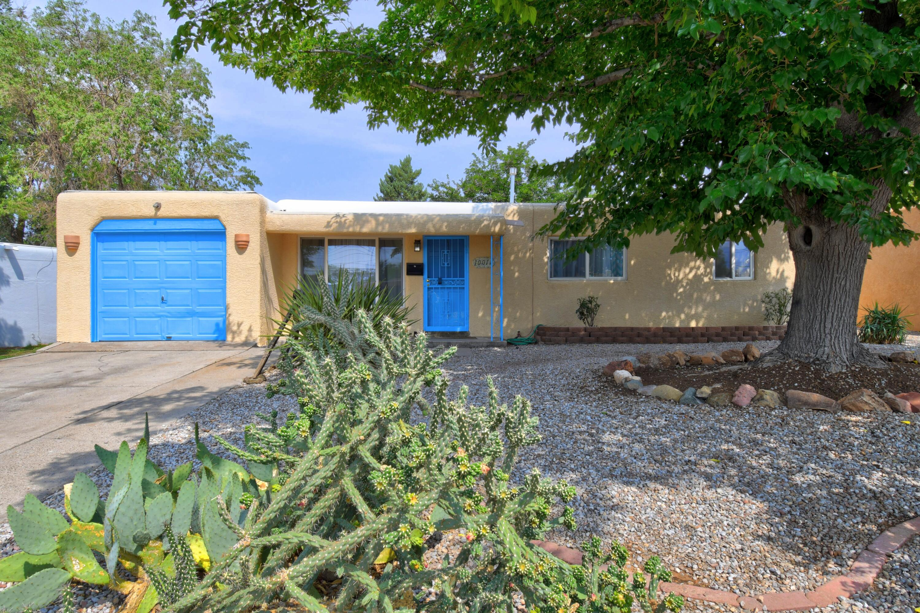 Such an adorable home on a charming NE Heights street!  So many quality updates! Sparkling clean and charming pueblo style  house. Tile floors in living room and hall way- brand new carpet in all the bedrooms! New luxury vinyl floors in kitchen and bathroom.  Bathroom tub has been resurfaced.  2021 TPO roof instalation, recently installed evaporative cooler, new sewer line from the yard to the city drop, newer electrical panel, vinyl windows, all new paint!  Large private yard and a 1 car attached garage with extra storage.  Bring your buyer today!!
