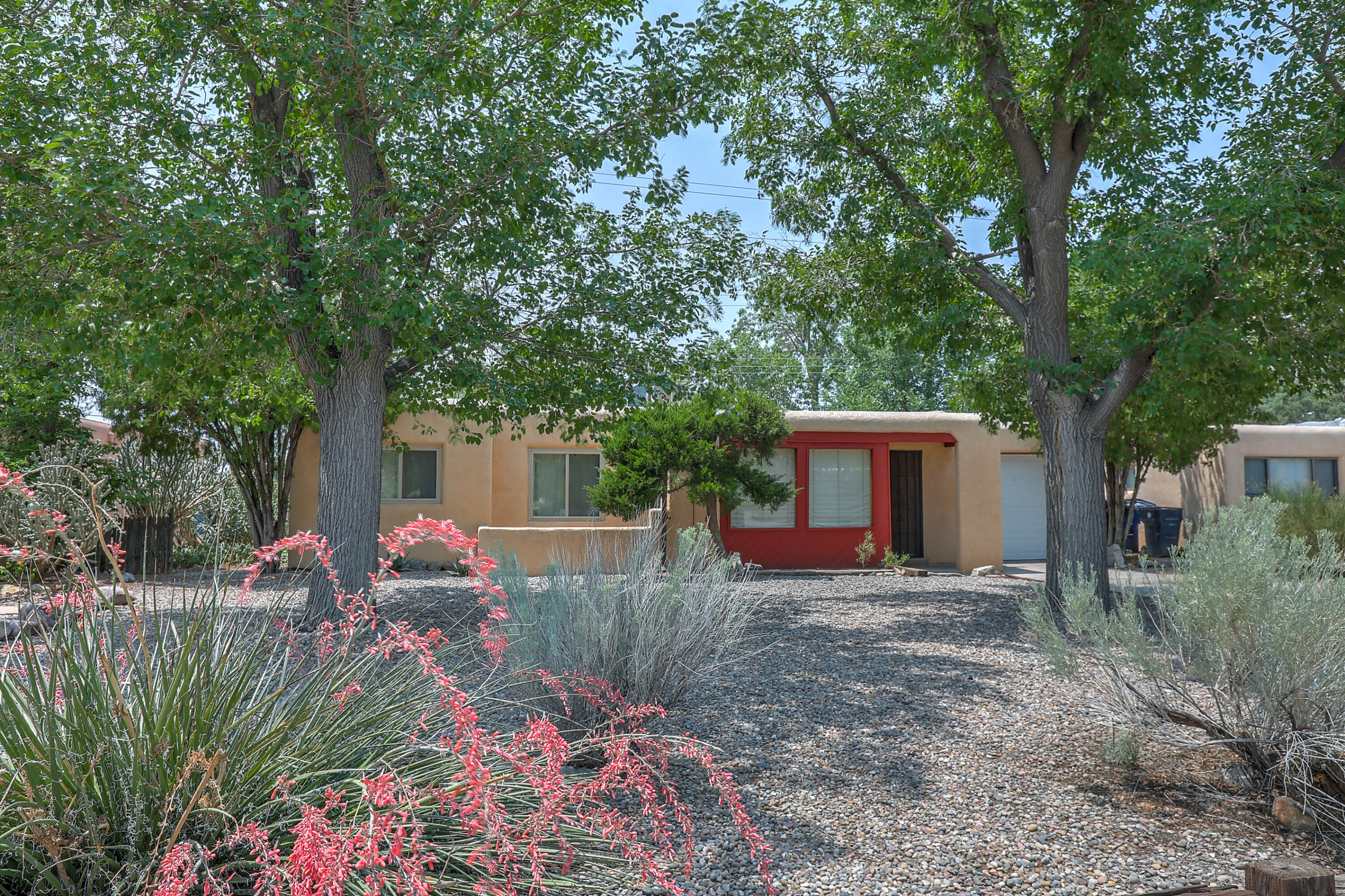 Fabulous Fairgrounds home with an amazing backyard! Walk to UNM area, State Fair, Sprouts, tons of parks, and so much more. Featuring 3 bedrooms, 1.75 bathrooms, and a 1 car garage this home as a lot to offer. The spacious living and dining area are flooded with natural light from the large windows. The kitchen has plenty of storage space too.  Kick back and relax in the grassy backyard, its a great entertainment space year round with the covered patio.