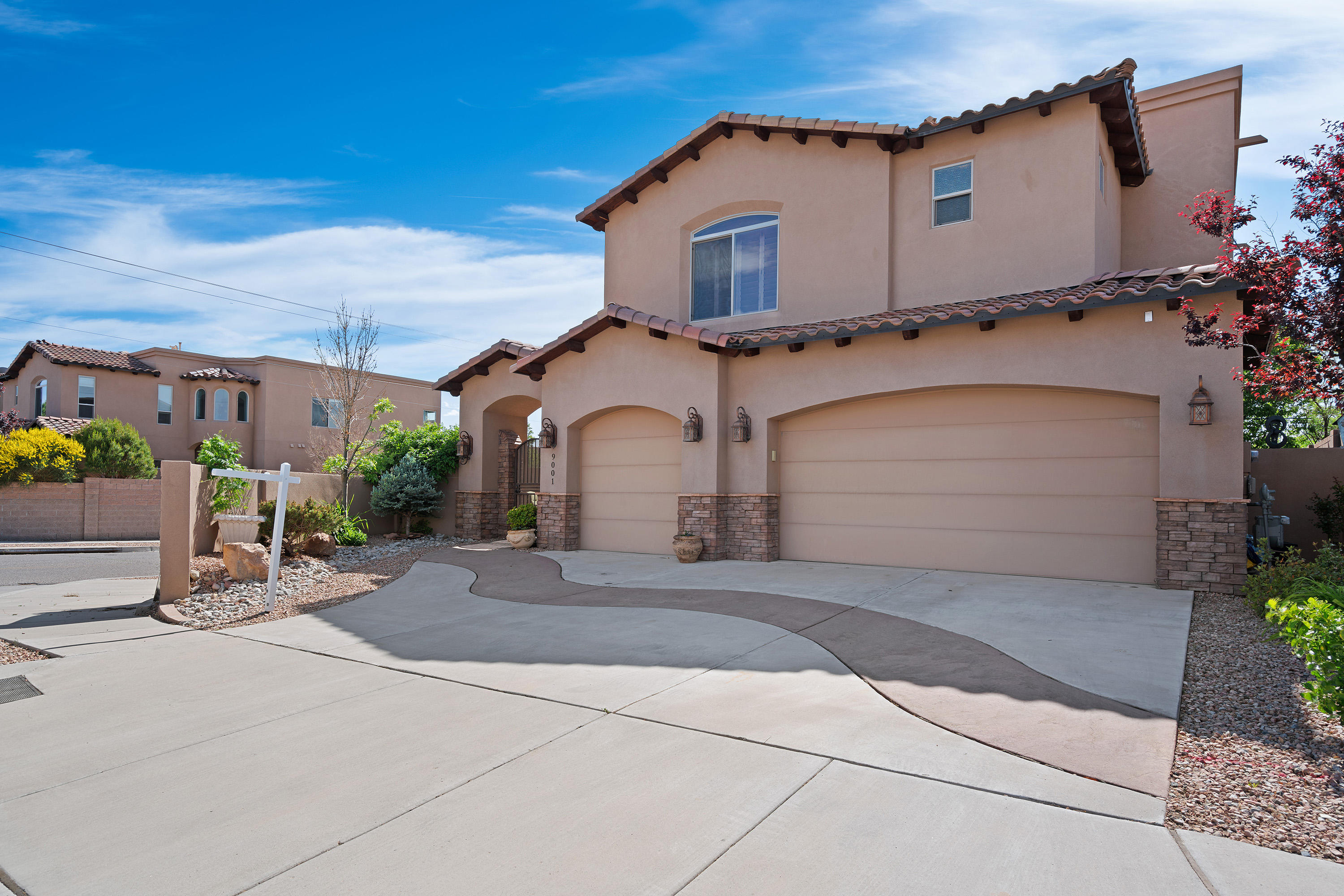 **OPEN HOUSE Saturday 2-7:30PM- Designed for comfortable living, TWO master bedroom suites featuring a striking Sandia mountain view also with a unique washer/ dryer located on each level! This luxurious home offers Travertine and hardwood flooring throughout, gleaming granite countertops Jenn-Air stainless steel appliances with a 6 burner gas range stove and a spacious 3 car garage with epoxy floors. UPGRADES include one of a kind interior wood shutters to last a lifetime, a two-story fireplace with a T & G ceiling and Stylish stone accents are customized throughout. Keep your utility costs low with dual high efficiency rated heating and cooling units programmed for each level protected by well insulated walls. Conveniently located near shopping, with views of balloon fiesta park. No HOA.