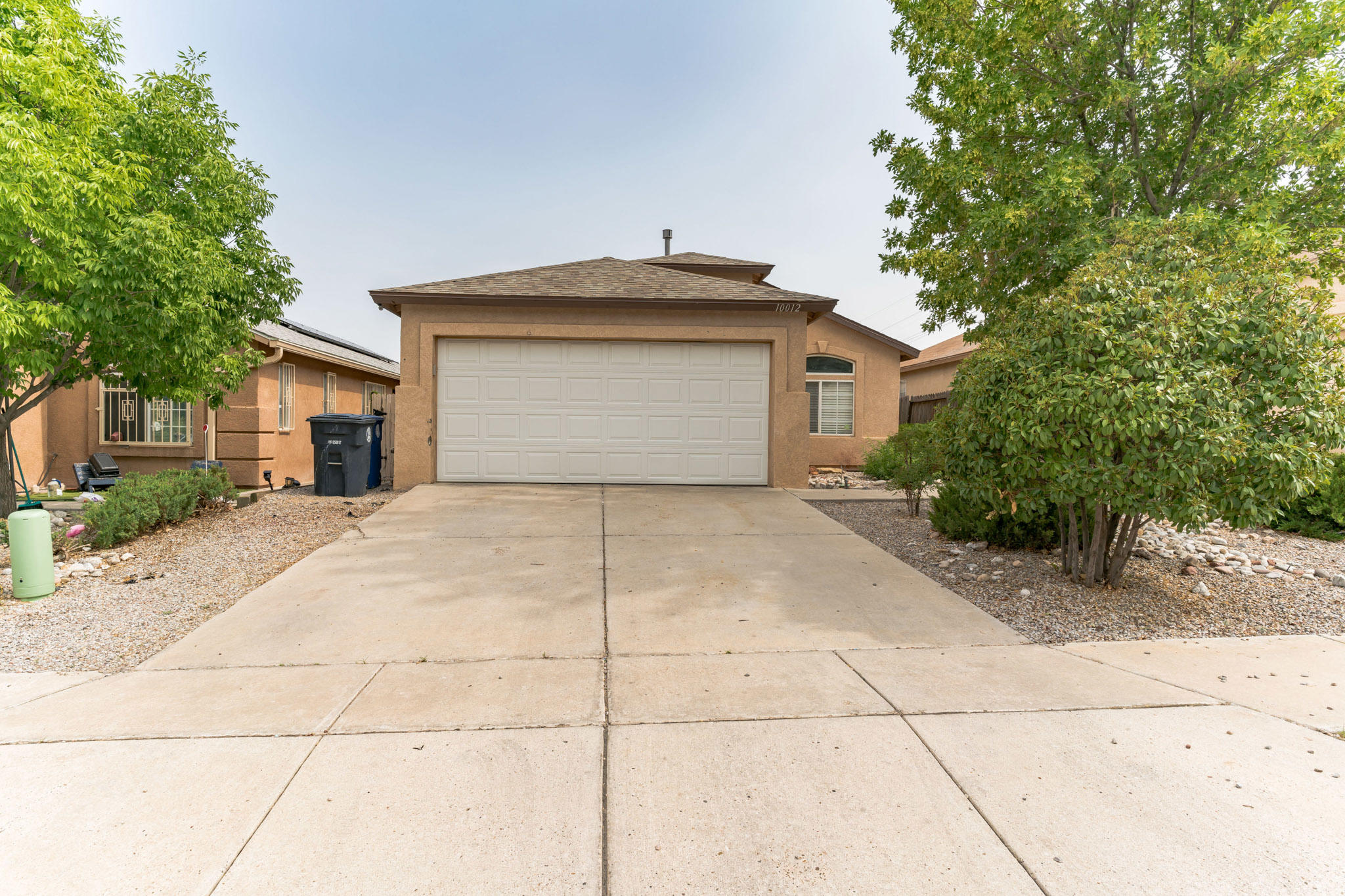 Move in ready house with new roof.  Features a spacious main suite with two closets, two vanities separate shower and bath.  Two living areas.  Backyard has little maintenance.