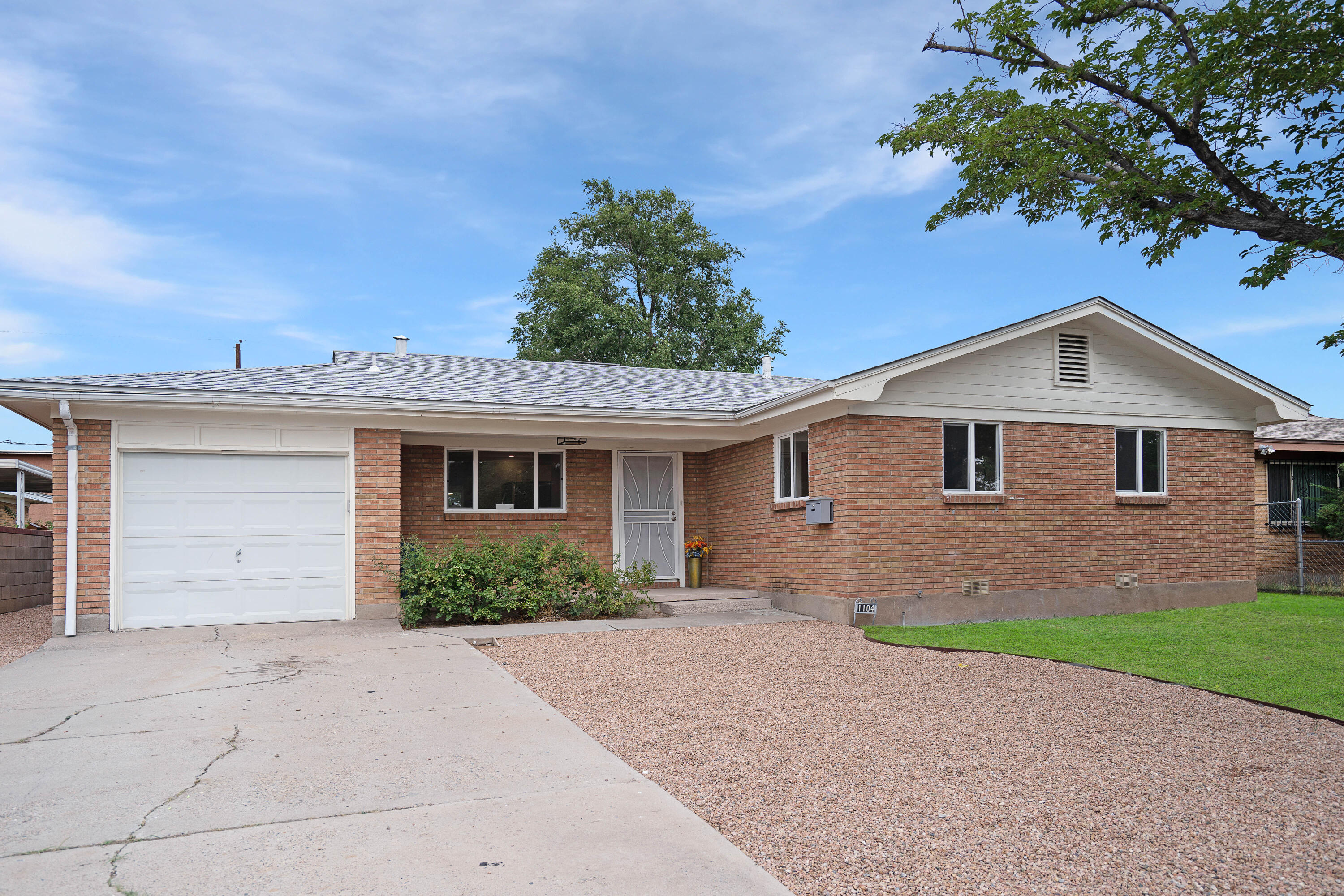 Welcome to this amazing renovation with new Refrigerated Air, Stainless Steel Appliance package, updated Kitchen, Bathrooms, bedrooms, and so much more. Enter to an open floor plan, designer luxury vinyl, amazing stacked brick fireplace, and recessed lighting throughout. The large new vinyl windows let in all the natural light. The kitchen is adorned with Quartz Countertop, large format tiles, & brand new cabinets. The dining room outlooks to the large backyard (w/ Backyard access!). The service room is oversized with its own entrance & soaking sink. Bedrooms have plenty of storage and the bathrooms are beautifully done with rainfall showers. New tile throughout the bathrooms! Located near Kirkland Airforce Base and easy access to shops. Schedule a showing today!