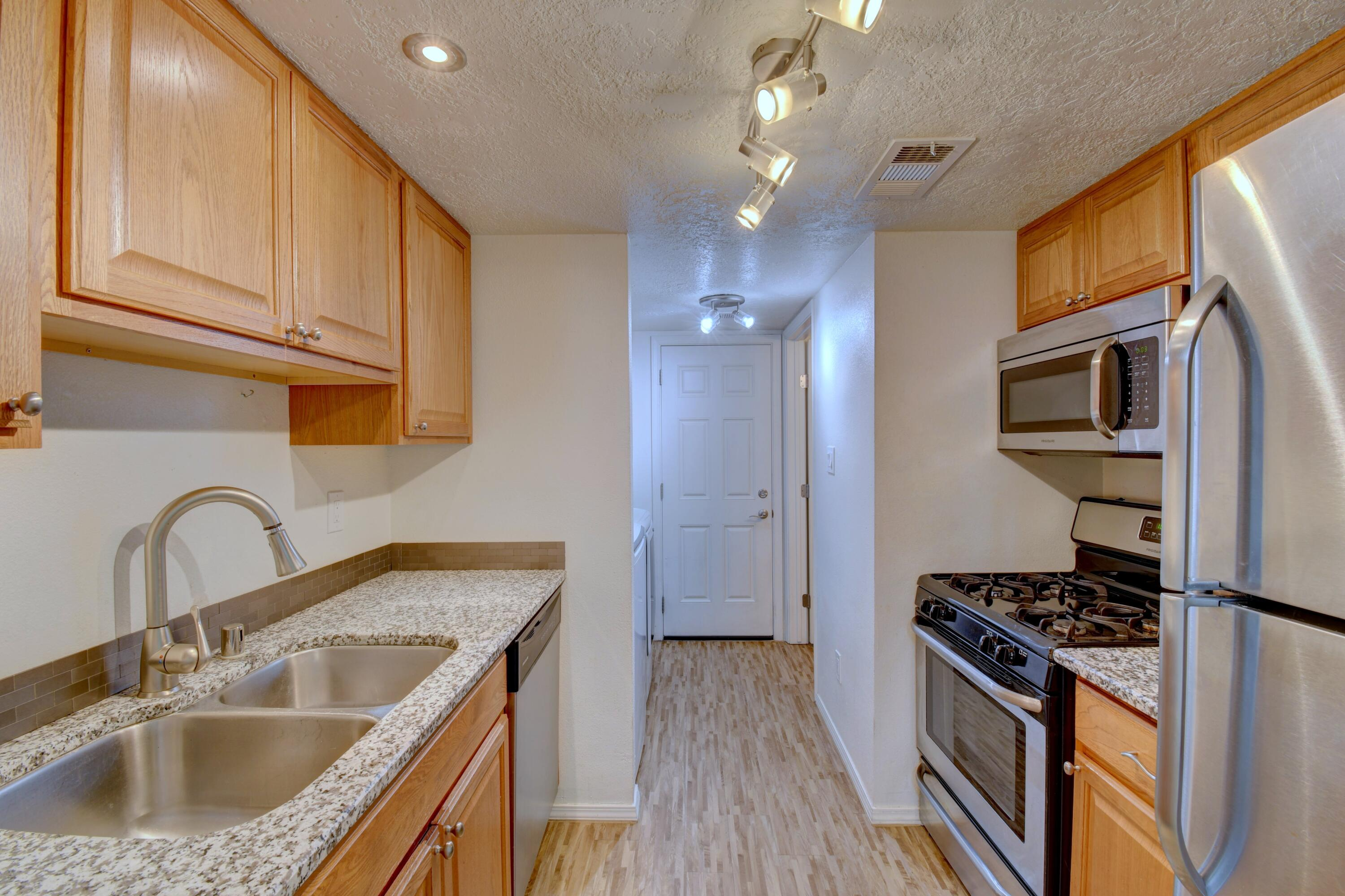 Super cute condo ready for its new owners.  Don't miss out!  Refrigerated air, updated kitchen and bathrooms, one car garage - ATTACHED!  All appliances are included. Water heater replaced in 2016.  HOA covers roof, stucco, grounds, water and trash.  HOA dues ($445) will go down in 4 1/2 years after 5 year renovation complete.  The renovation includes updating of the roofs, facades and fences.