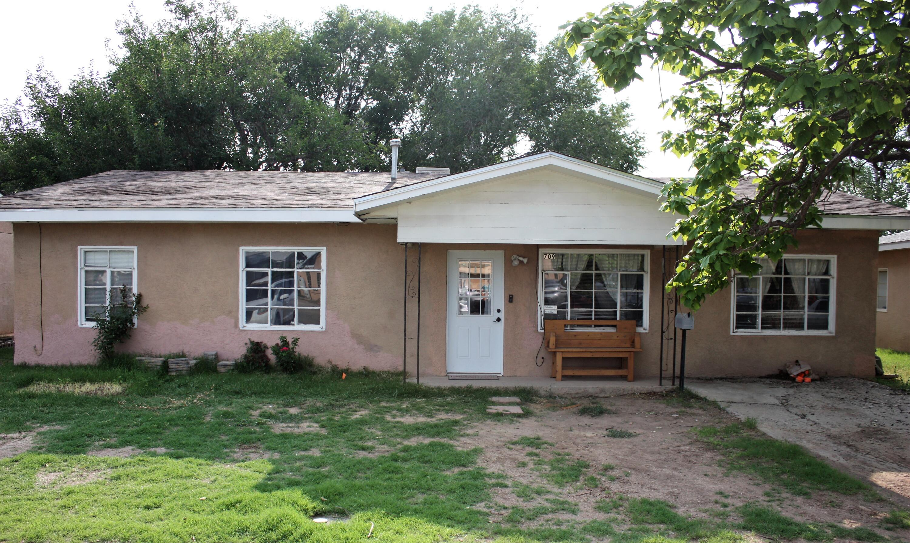 Nice 3 bedroom home with lots of character in heart of Belen. Nice kitchen update and possible second living room or possible 4th bedroom. Close to shopping and schools. Large back porch and big utility room complete this home. Great price with lots of potential.