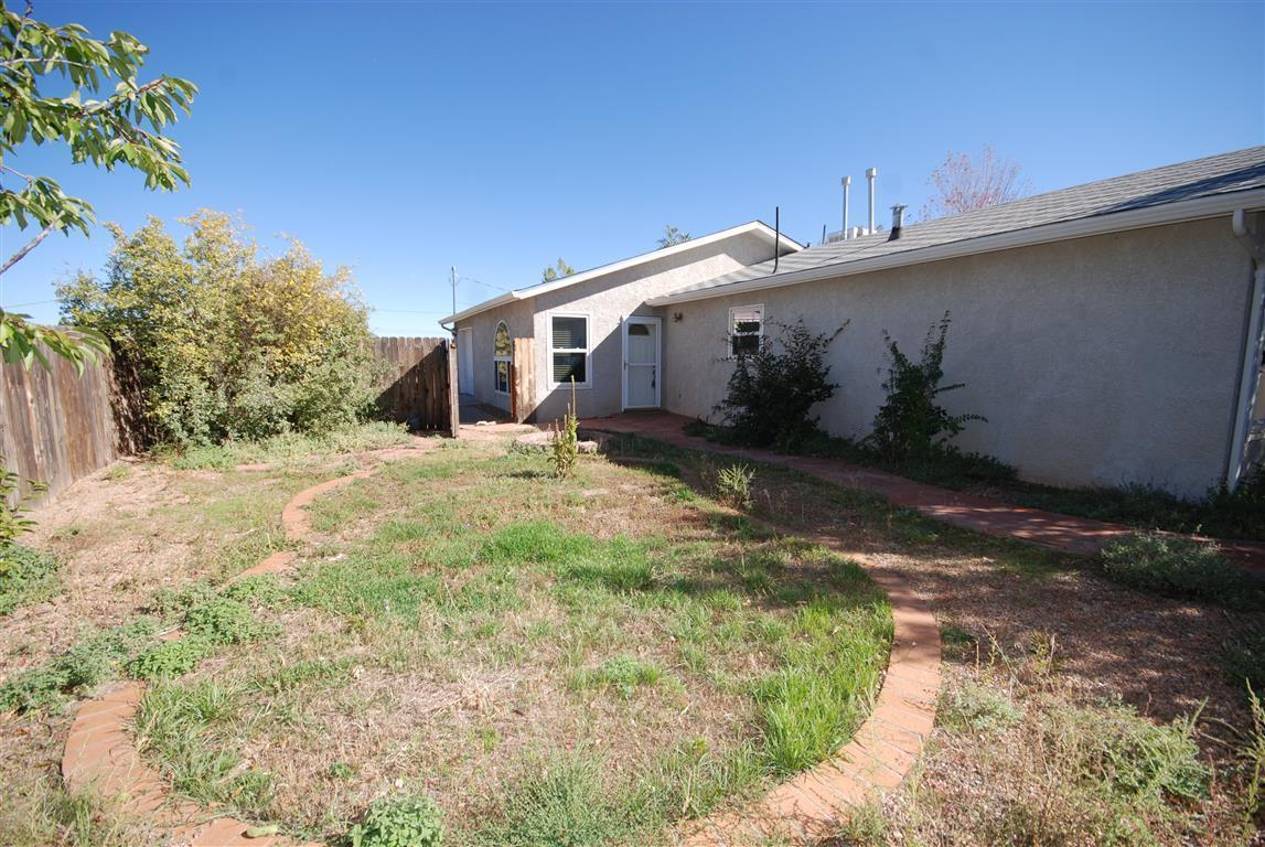 Great opportunity in Sandia Park.                   3 bedroom/ 2 full baths on 3/4 acre, all fenced. Private well , close to Sandia Crest Road, easy drive to Santa Fe