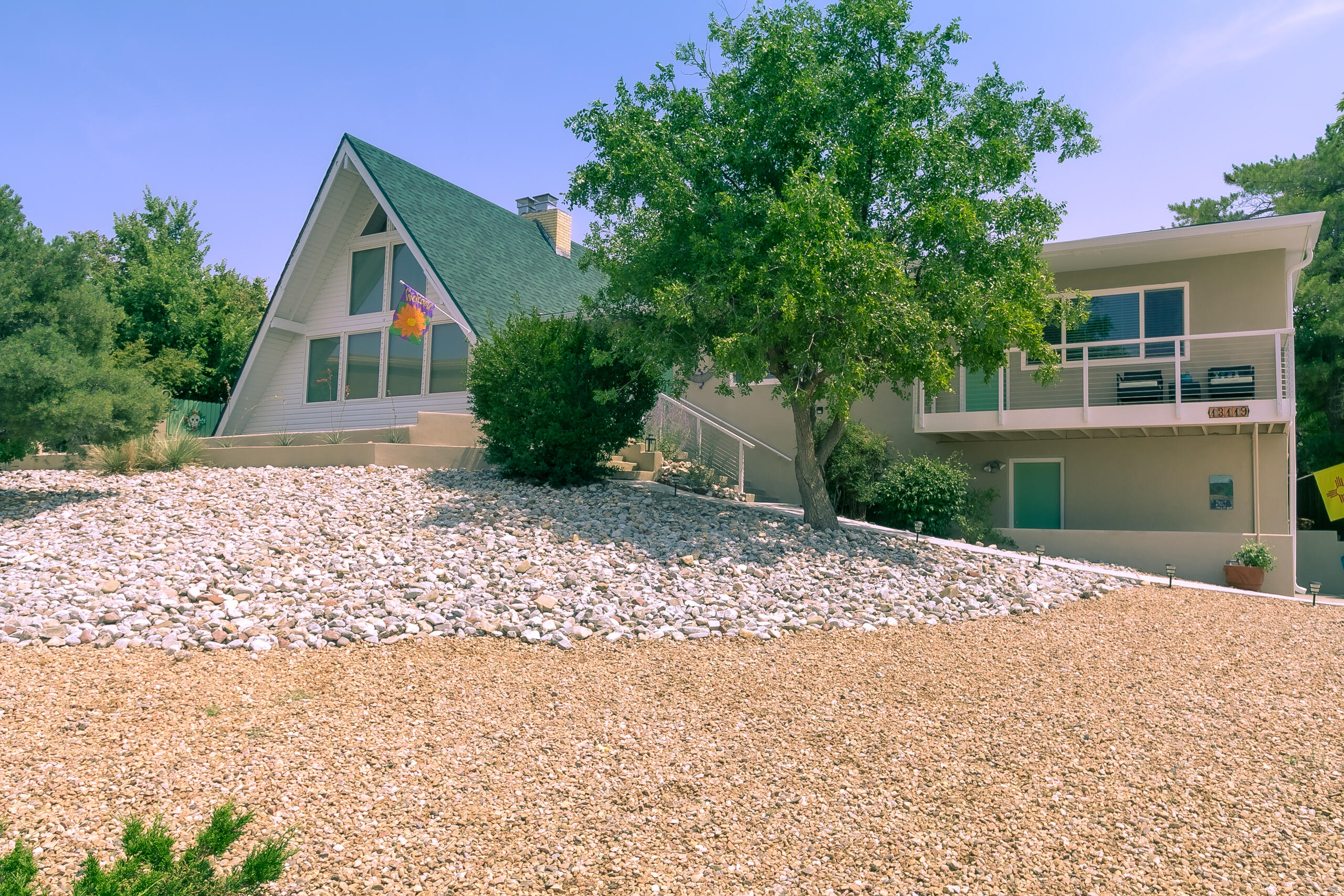 In the Foothills of ABQ located in popular Glenwood Hills is this beautiful home w/stupendous views on a .30 acre lot! The heart of the home is the living room w/soaring, beamed, tongue-&-groove cathedral ceiling, expansive wall of windows, & FP w/bookcases. Fam room & loft provide cozier, quieter escapes. Din room adjacent to kitchen w/stainless-steel appliances. MBR w/plentiful closet space, full bath & private view deck. Two addl bedrms served by full bath w/dbl vanity. Oak hardwd floors + tile & carpet. Laundry room (W/D convey!) Two car garage. Professionally landscaped backyard by Red Twig, w/walkways, numerous fruit trees & saltwater hot tub. Recent updates in the last 2 years incl roof; 200 amp elec svc; water heater; refrig A/C; ceiling fans; deck & stair railing; & new gutters.