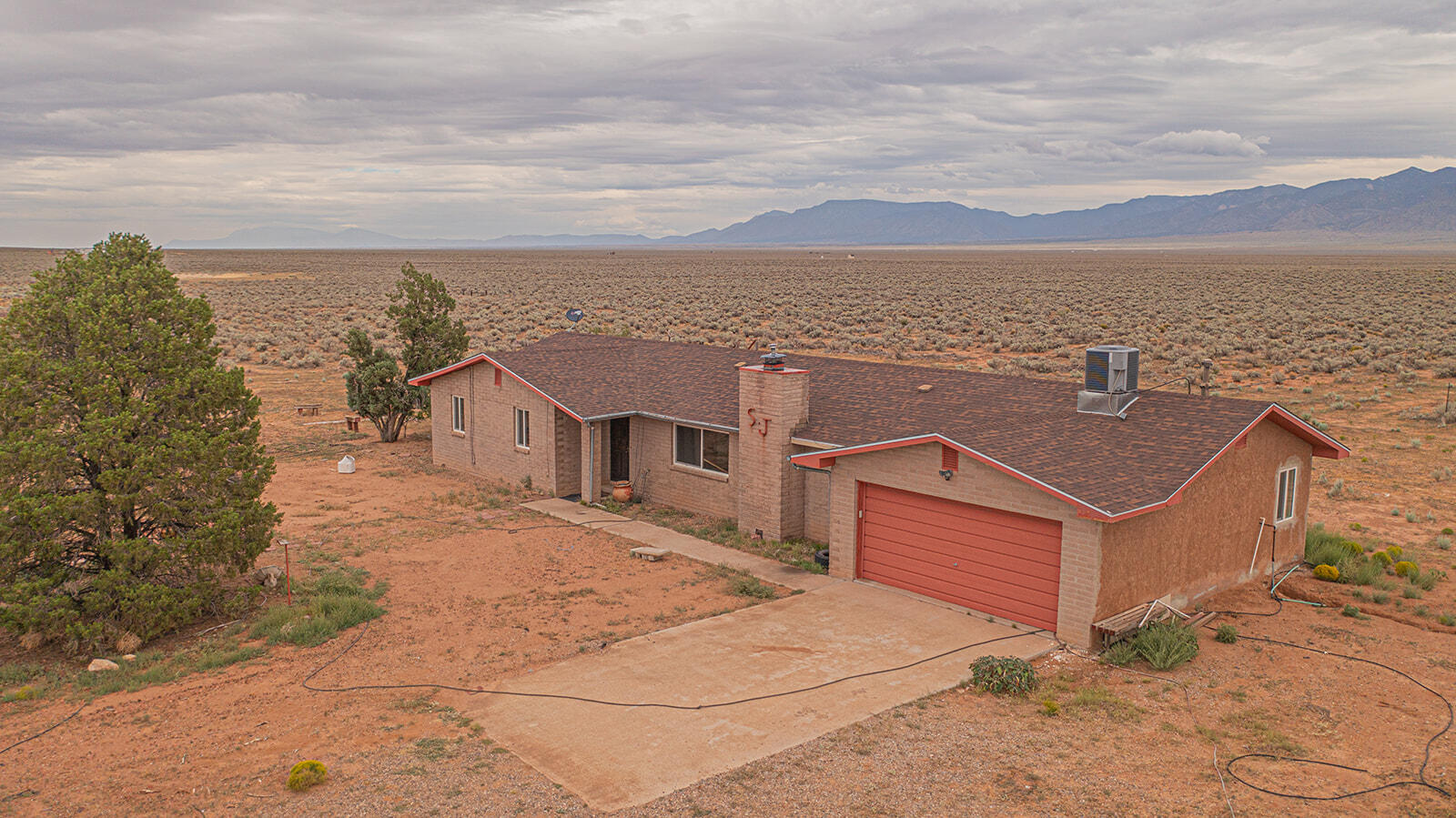 Custom home that sits on 10.82 acres. (Property can be split and build another home on it). The views of the Manzano mountains are gorgeous. Open floorplan that has a large kitchen and dining connected to the family room. Bonus sun room attached to home, Bonus office or bedroom or even a hobby room is another extra to this custom home. Fully fenced. Out buildings for storage. Bring the animals and enjoy the privacy. Close enough for shopping and commute but far enough away so very little noise.