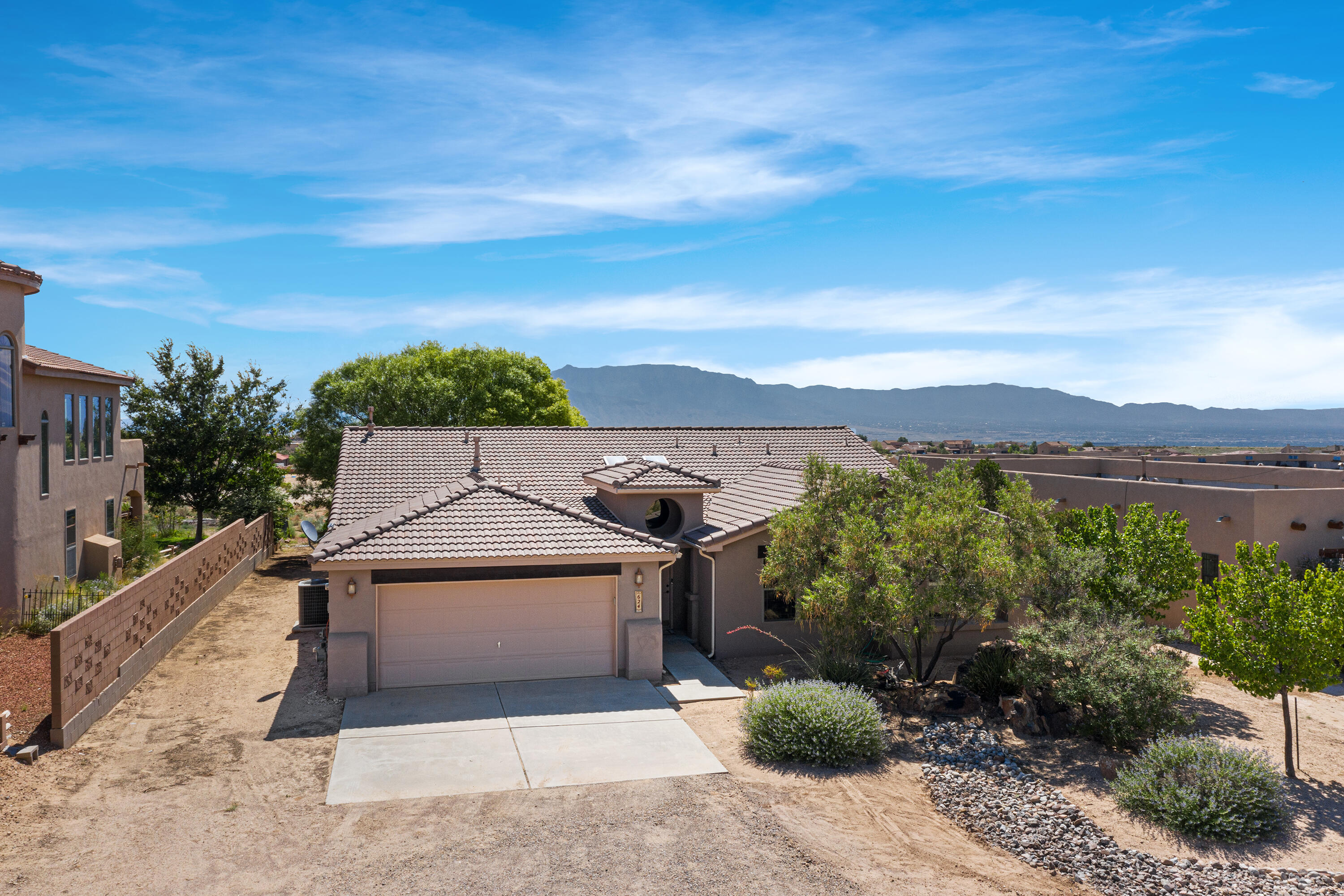 Come see this semi-custom Wallen Home with the most INCREDIBLE views!!  Set on a 1/2 acre, these may be some of the best views in Rio Rancho.  Relax outdoors and listen to your beautiful, oversized water feature, or just listen to the wind blow through the trees.  Enjoy the open floorplan with eat-in kitchen and gas appliances.  All bedrooms have NEW carpet, and master bedroom is an oversized comfort zone.  Master bath features dual sinks, a gorgeous walk-in shower and separate garden tub, plus great walk-in closet.  In addition, there's a great office with plenty of space. Plus, bring your toys! Garage has room for 3 cars with a tandem space, and there is side-yard access that can lead to the backyard for your camping toys.  Schedule your showing today!