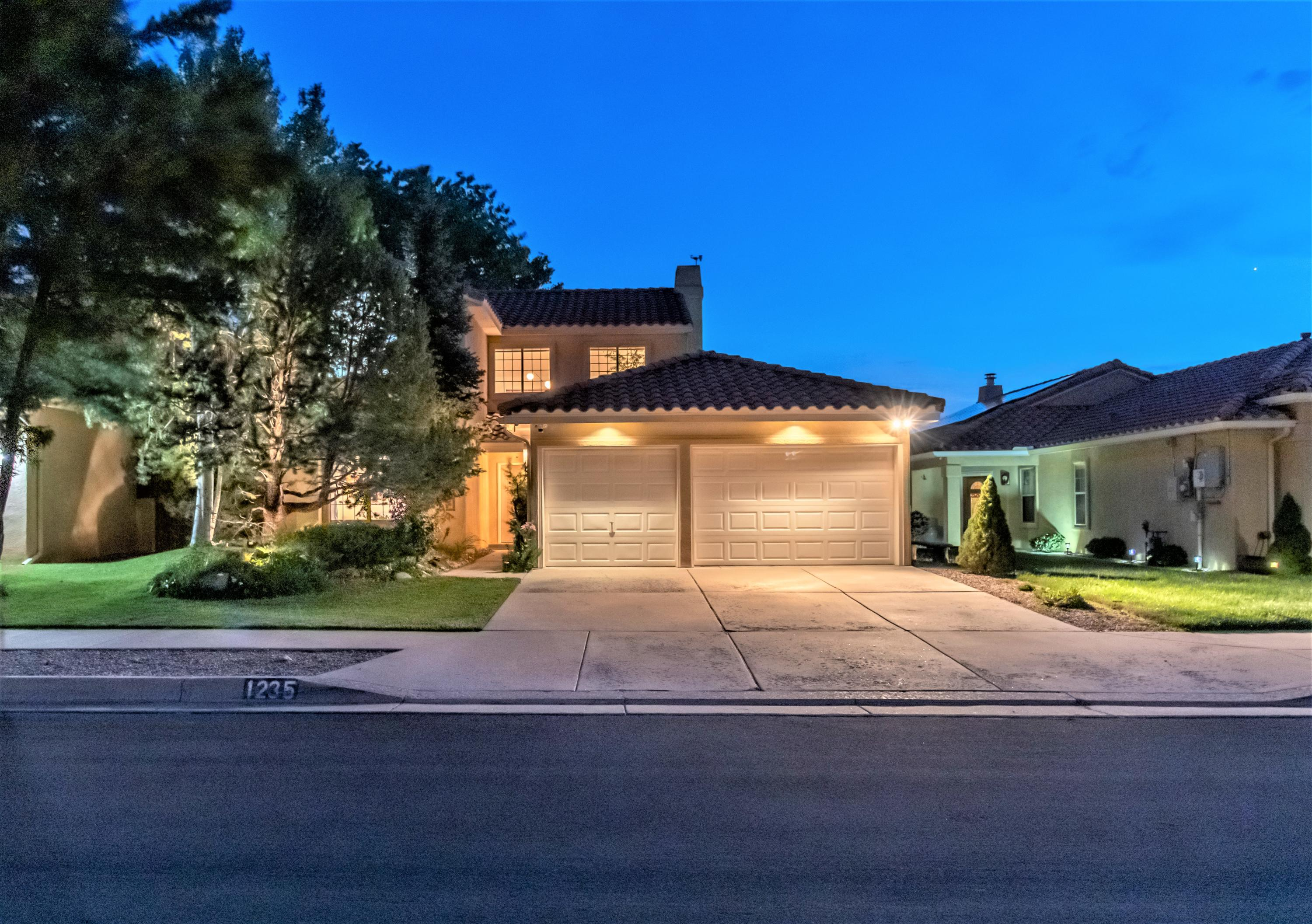 Nestled at the base of the foothills you will find this wonderful light and bright home build by Paul Newman.  This 4 bedroom 2.5 bathroom bi-level home with the main living areas on the upper level that takes advantage of the fabulous views.  Open floor plan with the great room opening up to the kitchen and dining room with a gas fireplace complete with a built in projector screen.  The primary bedroom is on the main floor with its own access to the back yard.  All secondary bedroom are good sized.  The three car garage with lots of shelving for extra storage.  This is definitely a must see .
