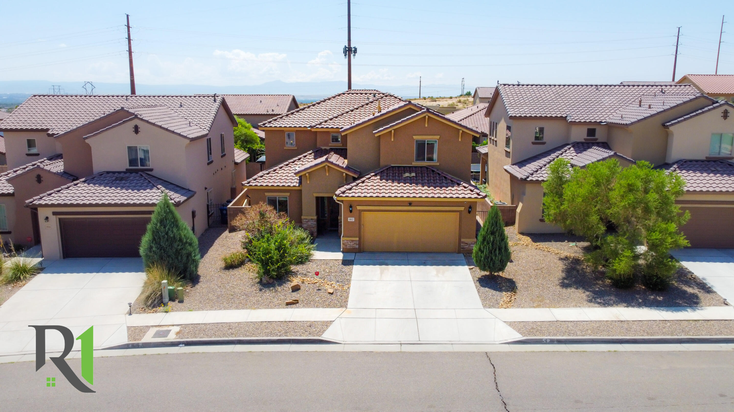 5 bedroom 4 full bath home with two living areas. Master bedroom is on the main floor the bath has a separate  shower and tub. There is an office with french  door on the main floor.